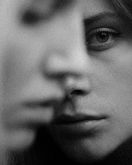 two faces in black and white shot by Adrian Villagomez