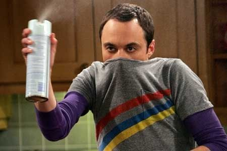 Sheldon from Big Bang Theory covering his nose spraying can in the air