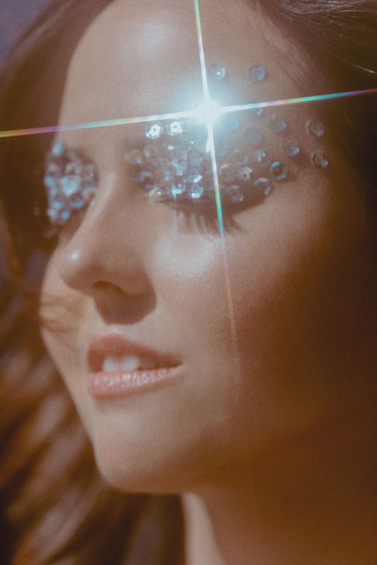 Ariane Moffatt shot by Kelly Jacob for her album Petites Mains Précieuses with silver sequins on her eyelids