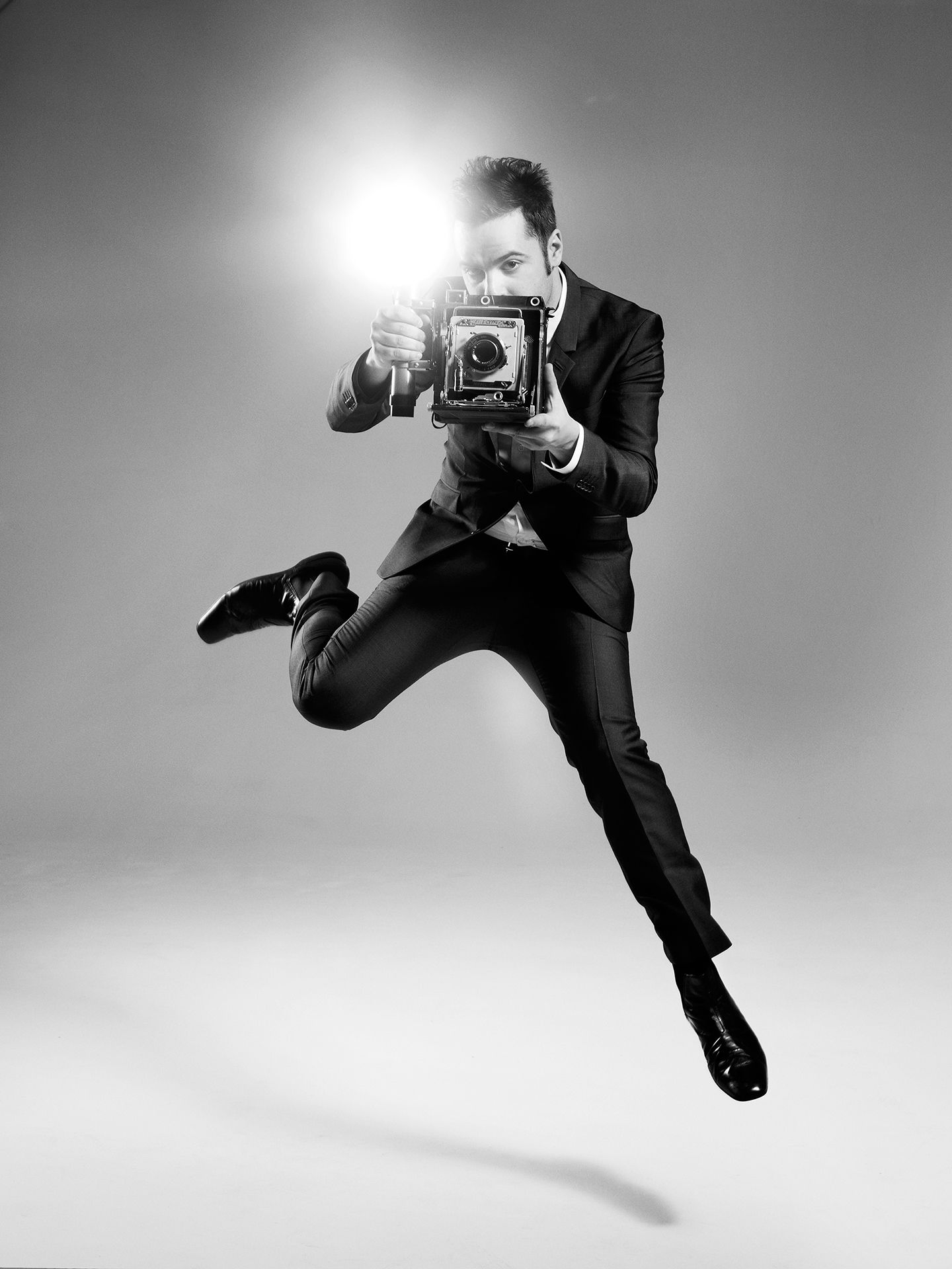 Dumas photographed jumping in the air by Jocelyn Michel for JUMP personal series