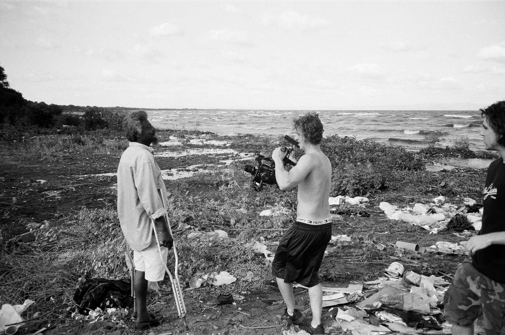 Marco Gilbert and Vincent Ruel-Cote from Les Gamins filming disabled man on beachside for Karim Ouellet music video of La Mer A Boire