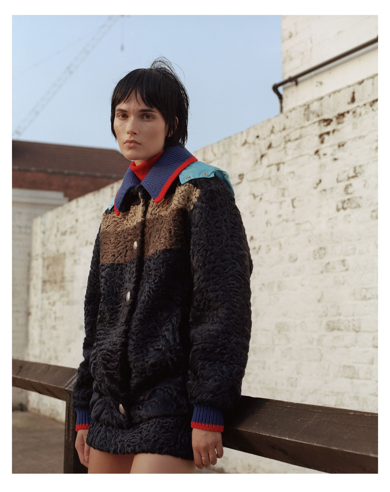 black haired model wearing fluffy colourful coat by Maxyme G Delisle for Fraulein Magazine fashion editorial