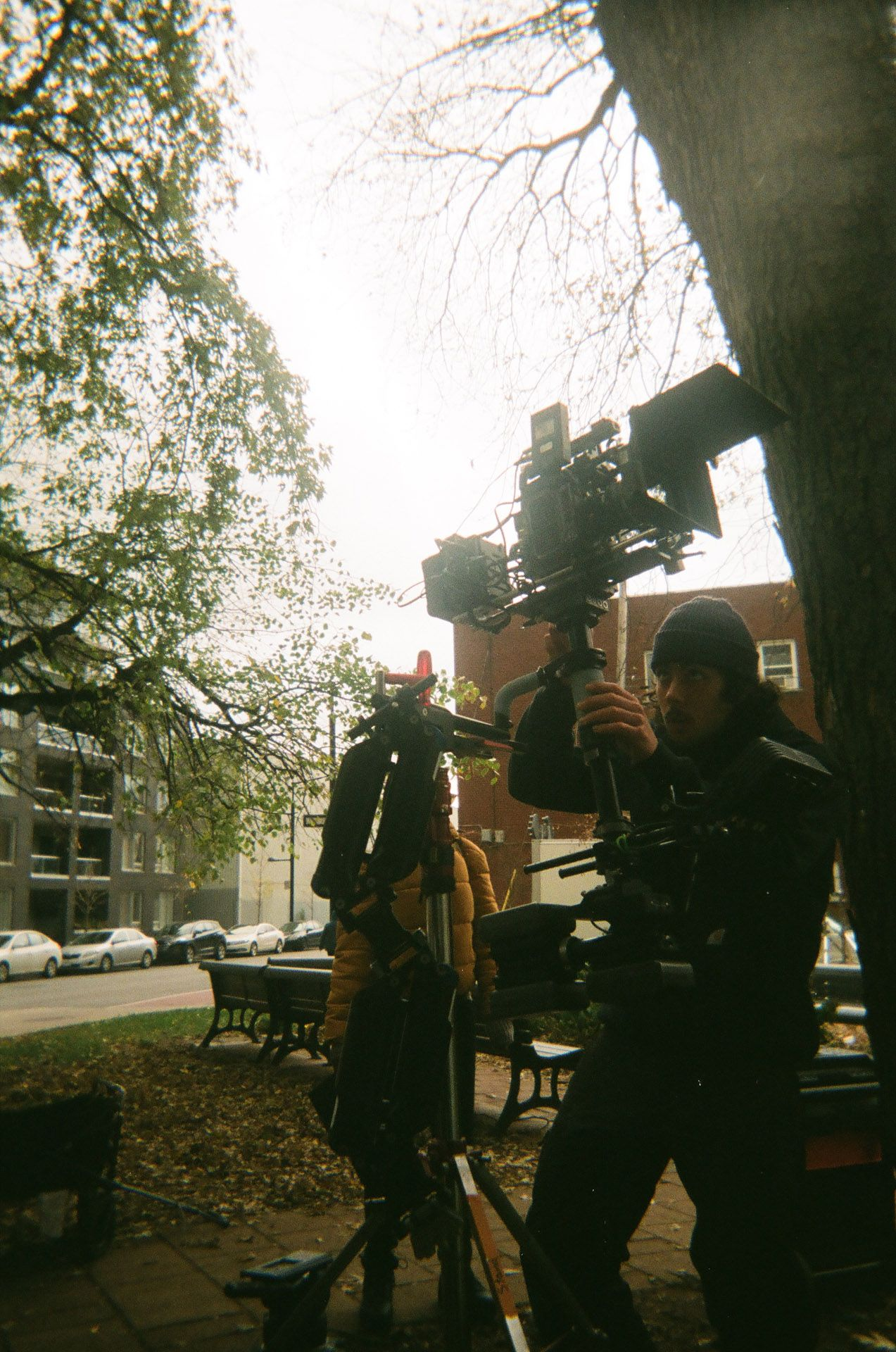 camera assistant filming with camera held up high in behind the scenes of TV series La Loi C'est La Loi filmed by Les Gamins for TV5 Unis