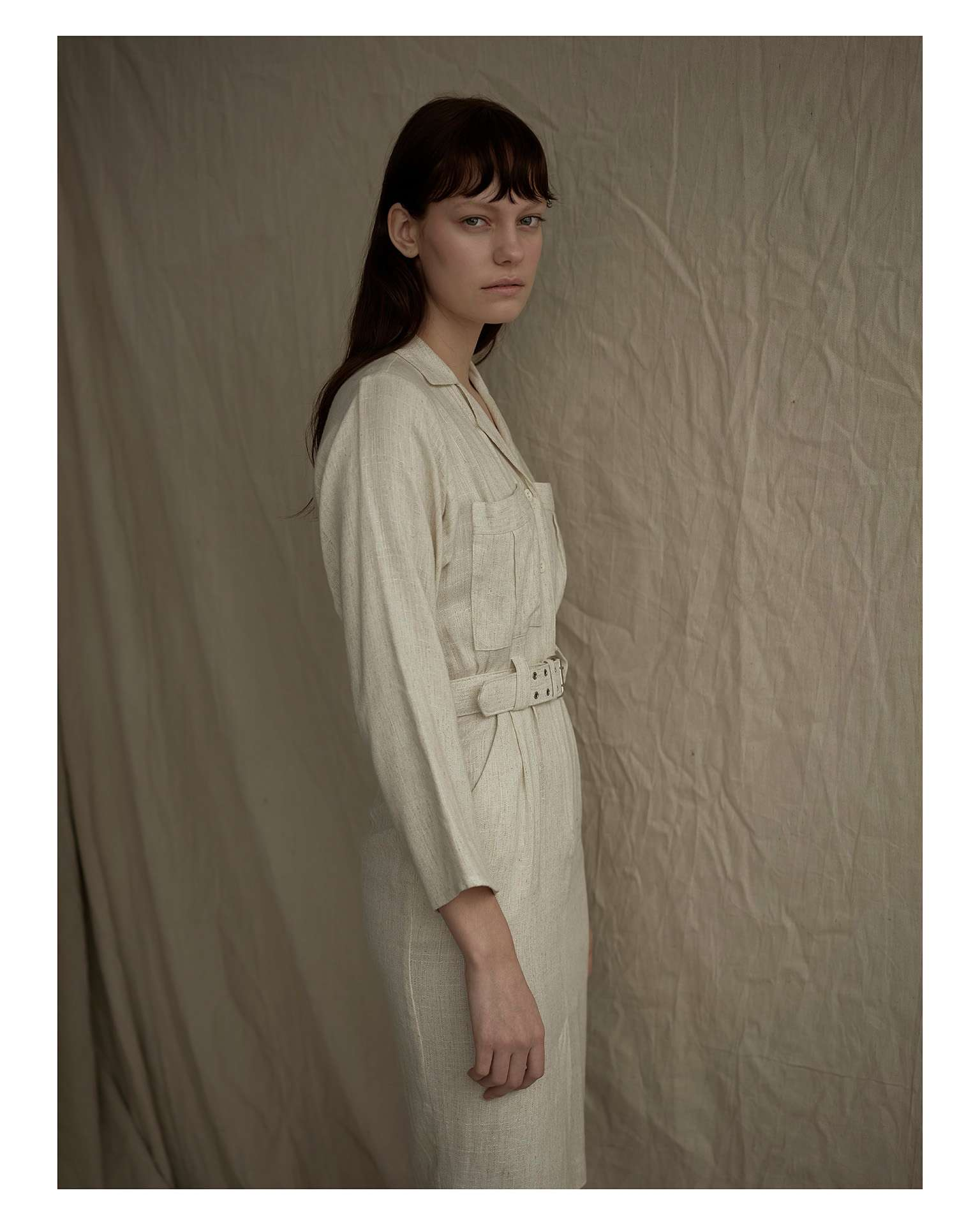 woman dressed in white overall on beige fabric background by Maxyme G Delisle for Mariane