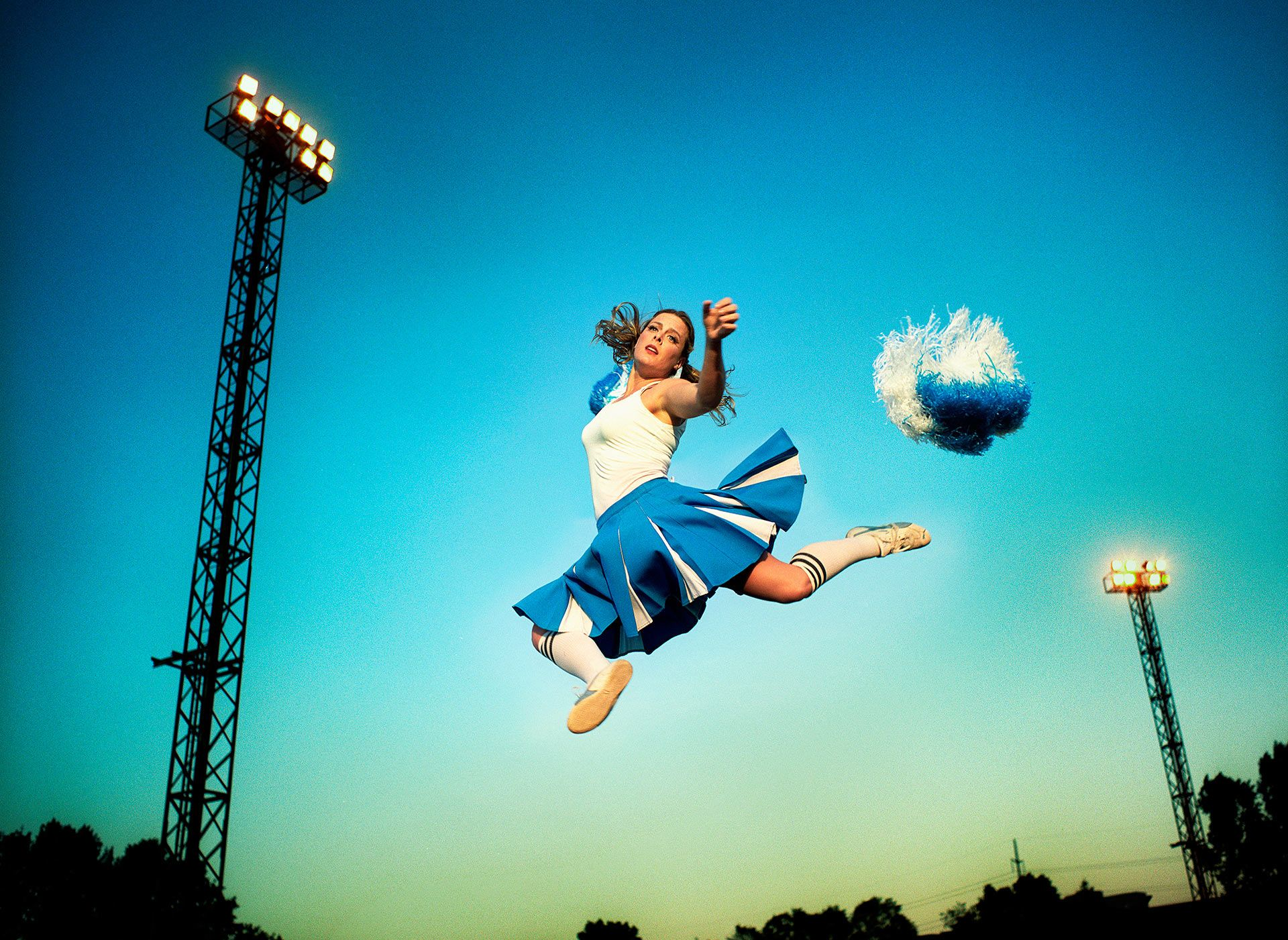 cheerleader jumping in the air for Admissions by Jocelyn Michel
