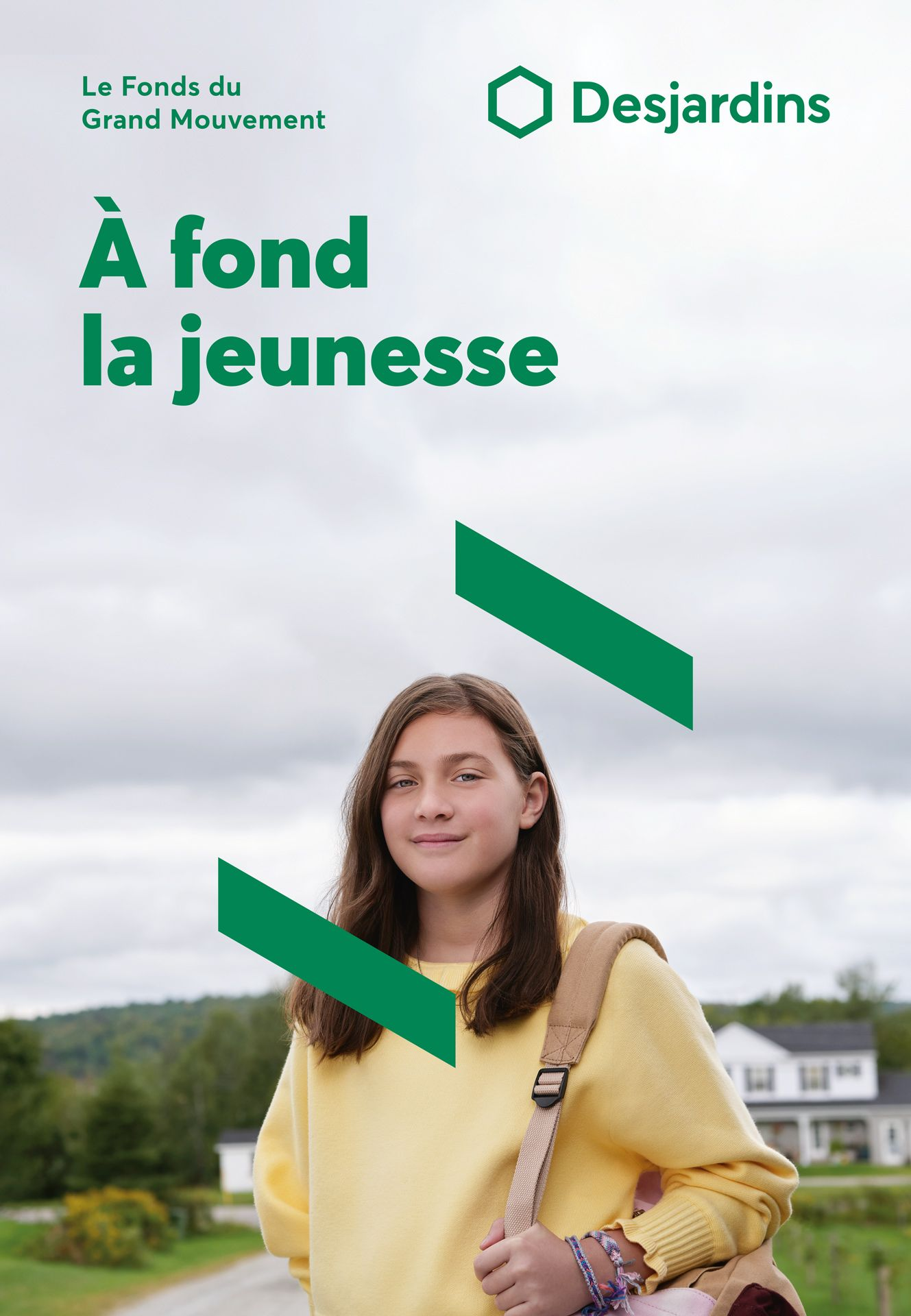 young girl with long brown hair wearing light yellow sweater with backpack on her shoulder looking at camera with graphic elements around her photographed by Maxyme G Delisle for Desjardins campaign with Bleu Blanc Rouge