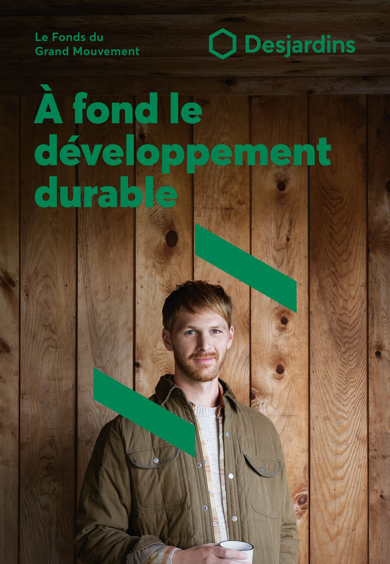 ginger haired man with beard wearing khaki jacket holding white cup looking at camera with graphic elements around him photographed by Maxyme G Delisle for Desjardins campaign with Bleu Blanc Rouge