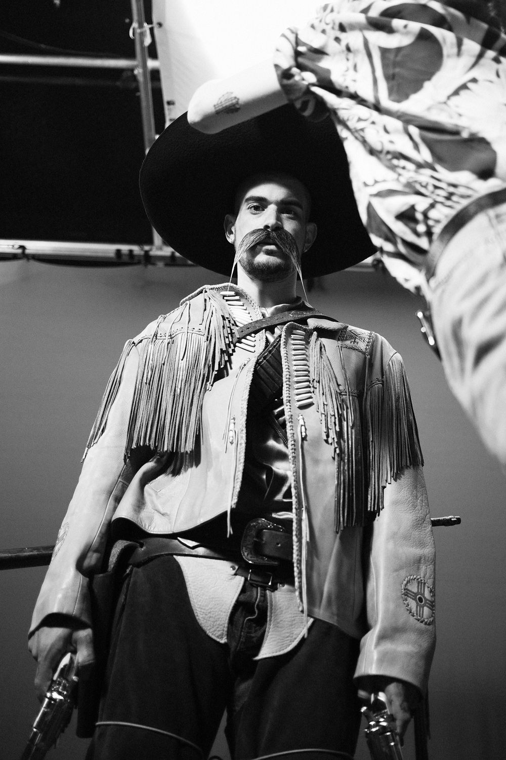 behind the scenes of rapper Koriass wearing mexican cowboy costume looking at camera on set of music video 5 à 7 filmed by Vincent Ruel-Cote from Les Gamins with 7ieme Ciel Records