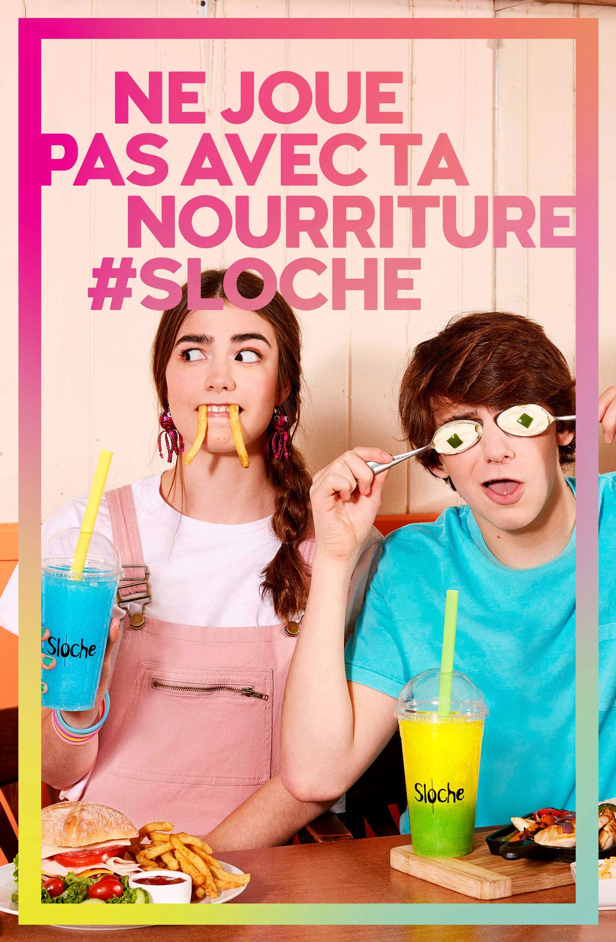 two teenagers with junk food making funny faces holding slurpees by Jocelyn Michel for Sloche Couche Tard with Havas
