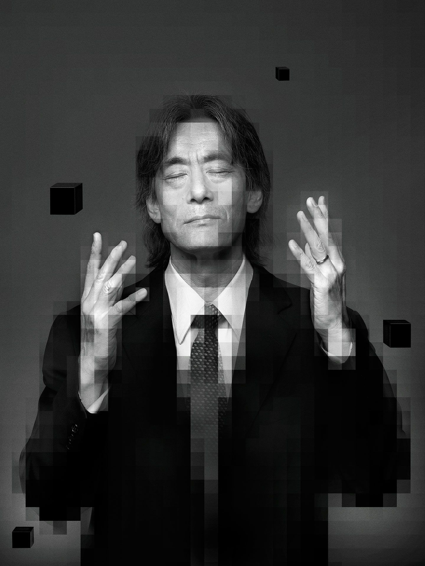 Black and white portrait of Kent Nagano with a pixelation effect.