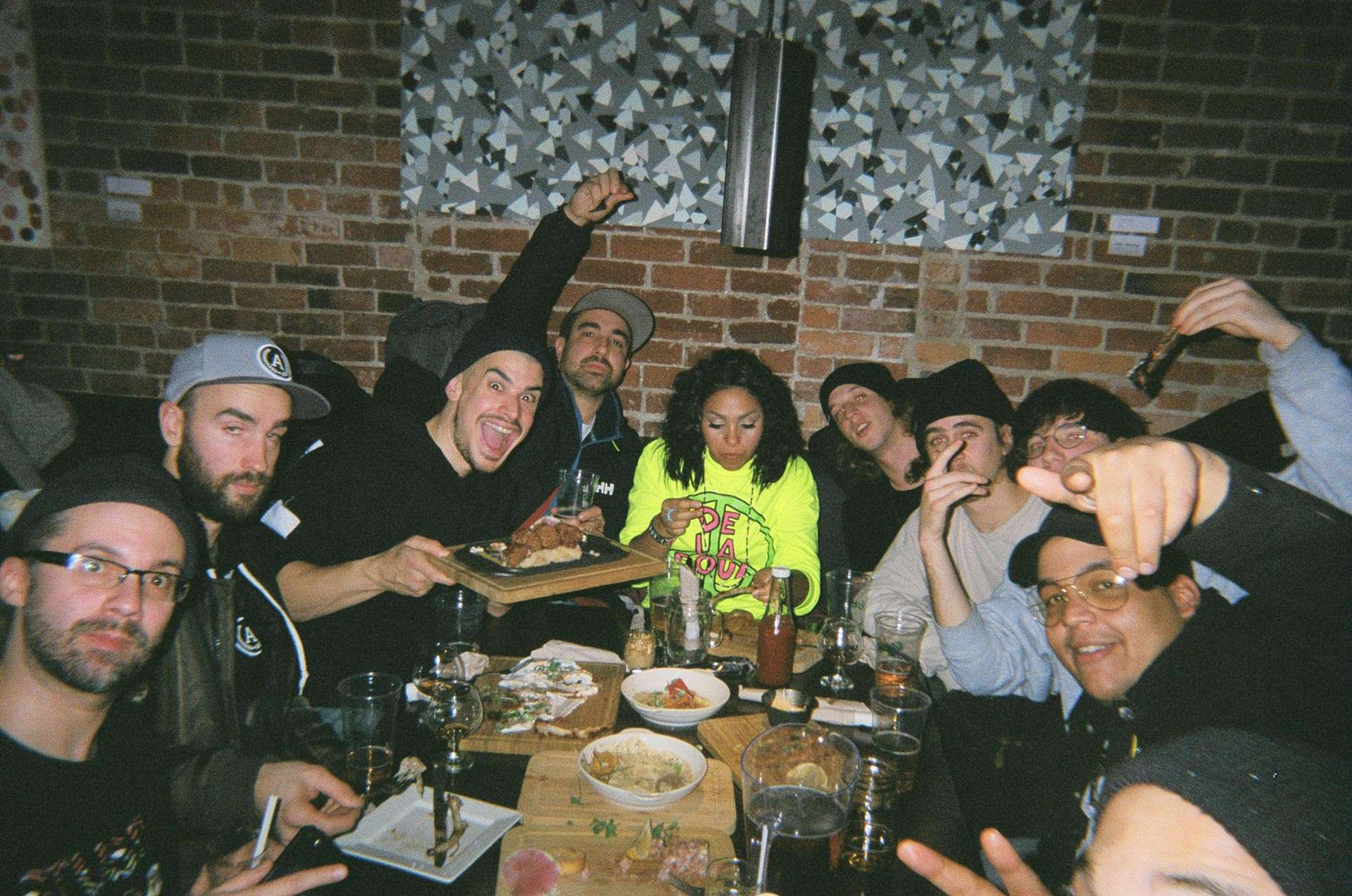 team of L'Osstidfilm documentary filmed by Vincent Ruel-Cote from Les Gamins about L'Osstidtour all eating together at restaurant smiling and laughing