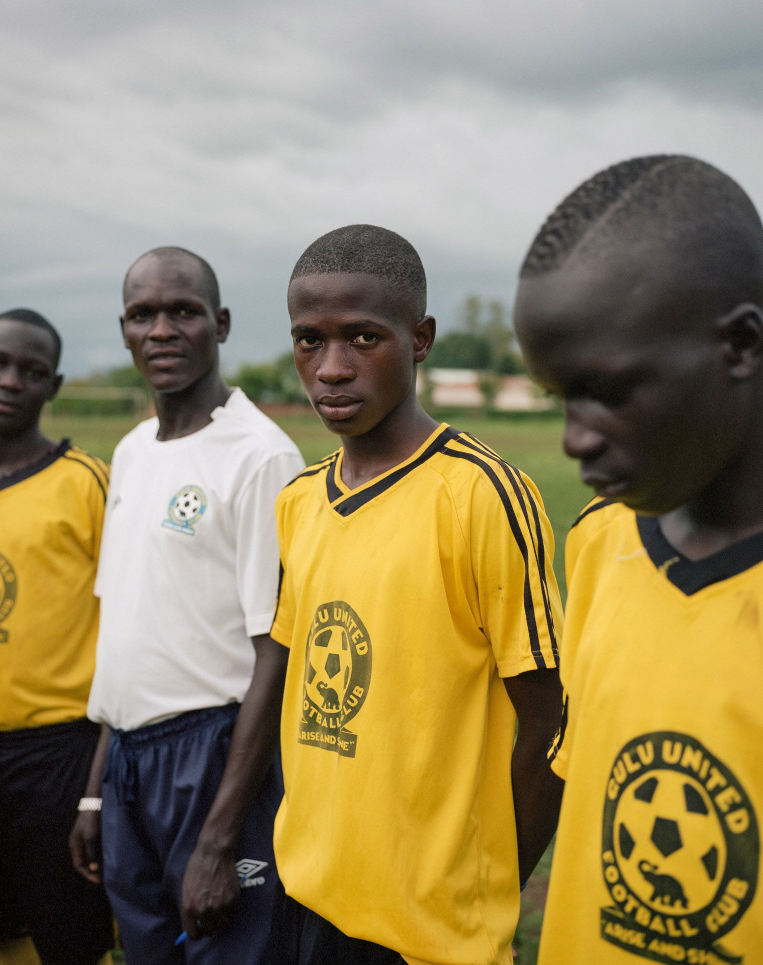 young black boys playing soccer for United Football Club by Alexi Hobbs in Uganda for Football for Good with Sportsnet