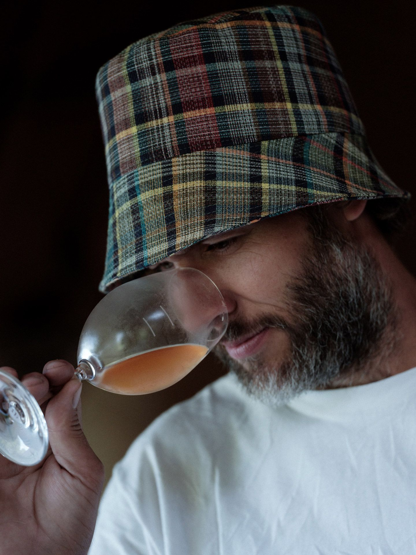 winemaker from Pinard & Filles smelling a glass of orange wine by Alexi Hobbs for Larose Paris