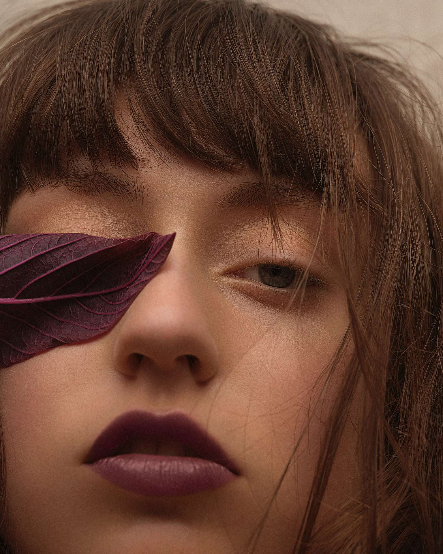 model Delphine with purple lipstick and purple leaf over her eye by Maxyme G Delisle for Flanelle Magazine