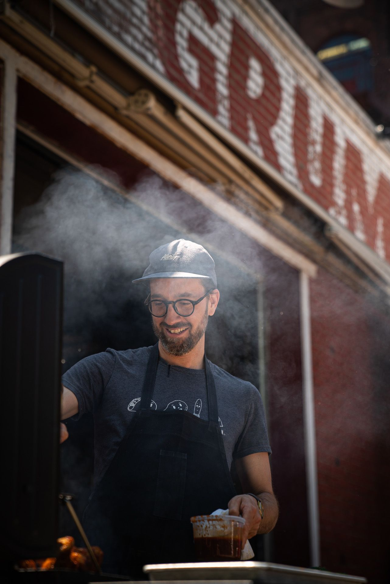chef Sebastian Harrisson-Cloutier grilling meat on the barbecue by Bruno Florin for Van Houtte 100th anniversary