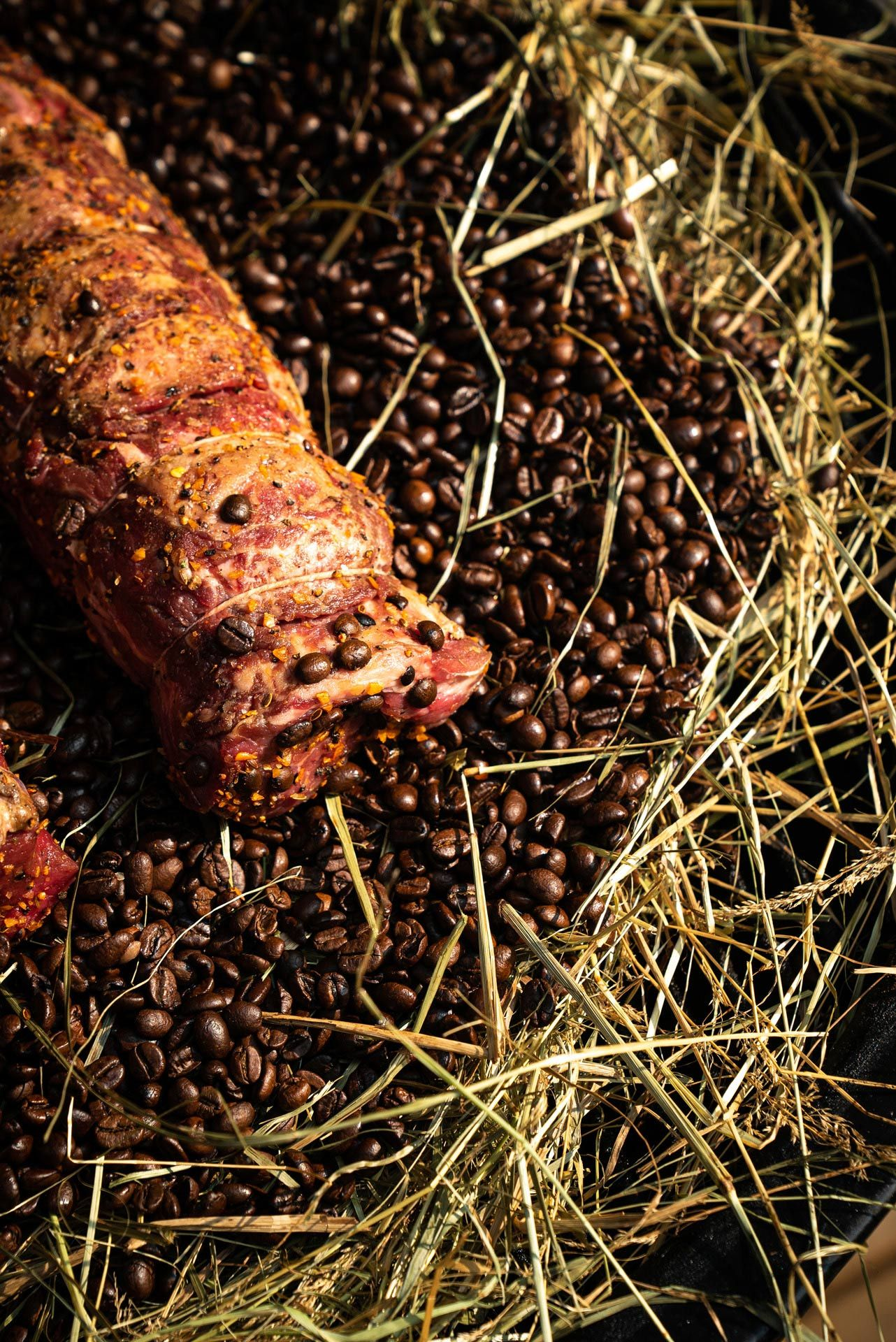 meat prepared chef Ted Reader slowly cooking over coffee beans and hay by Bruno Florin for Van Houtte 100th anniversary