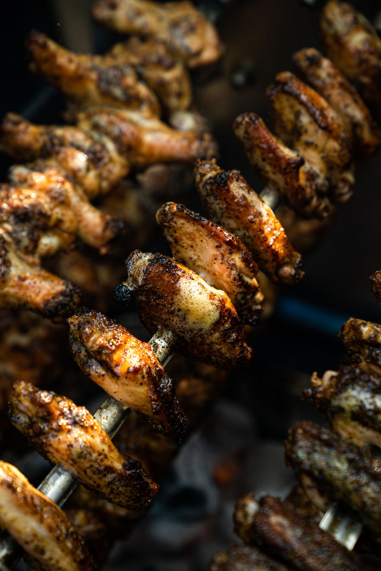 close up of chef Ted Reader cooked chicken wings skewers by Bruno Florin for Van Houtte 100th anniversary