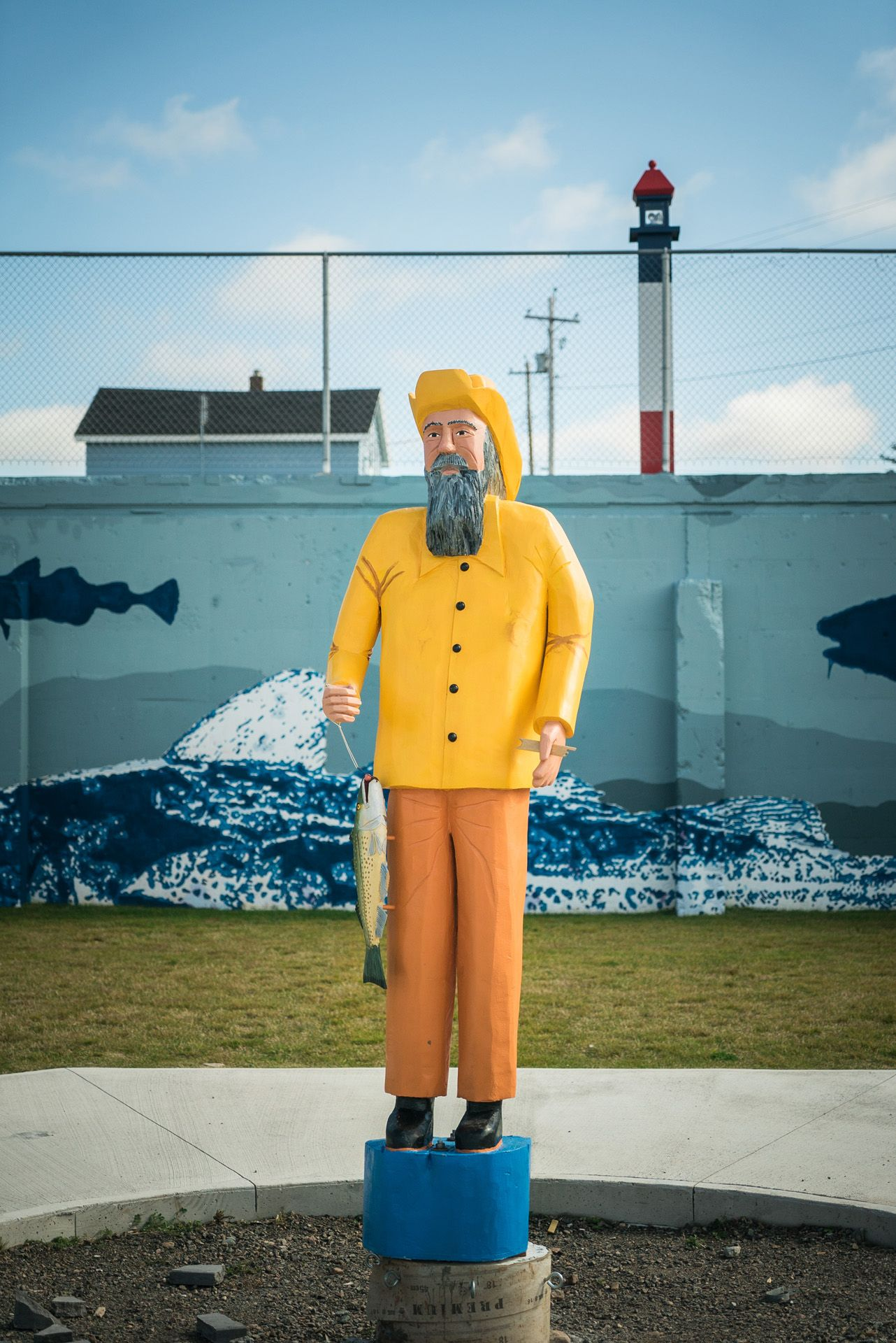 wooden and painted fisherman statue by Bruno Florin for Mercedes Magazine