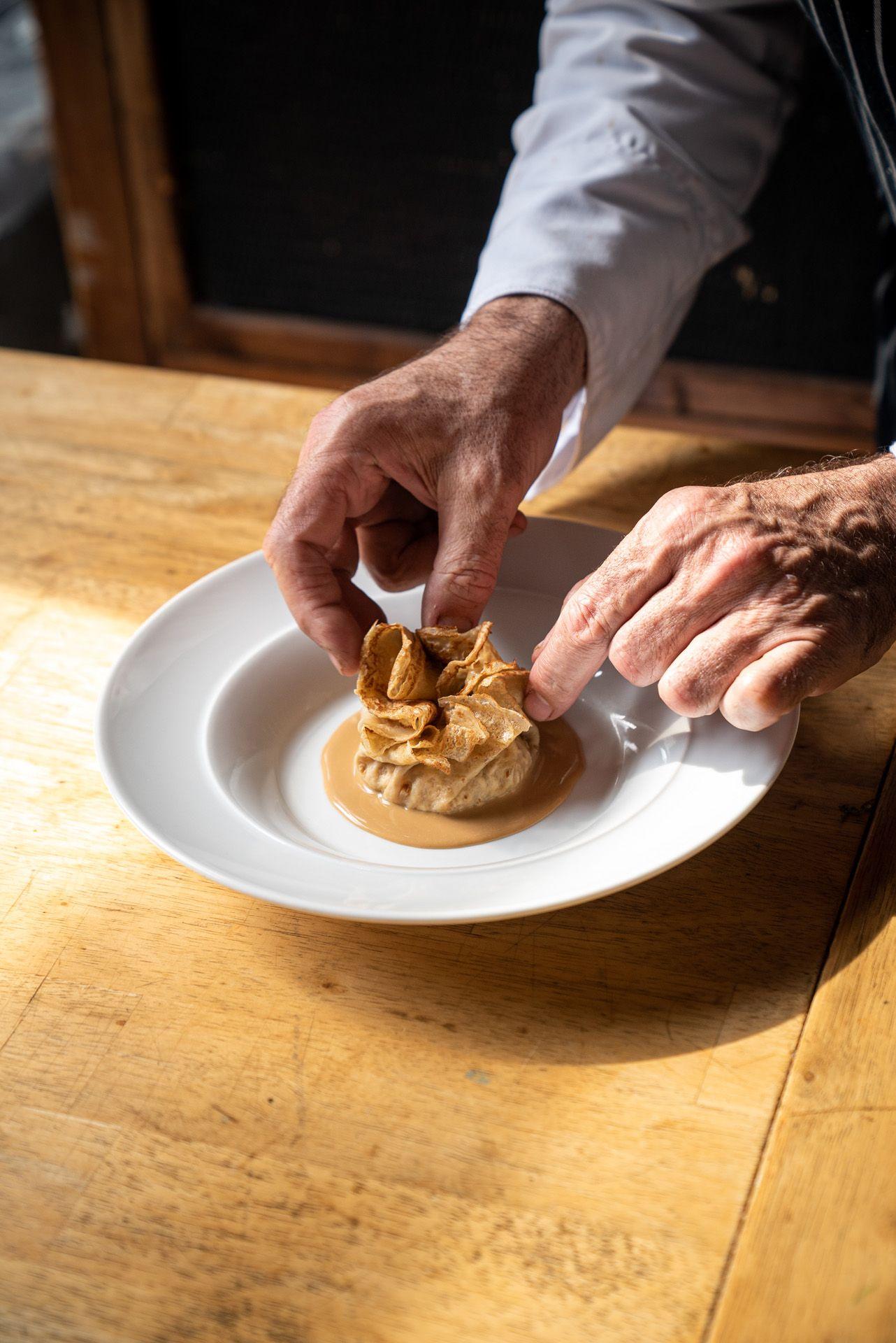 chef Didier Leroy plating feuilleté dessert by Bruno Florin for Van Houtte 100th anniversary
