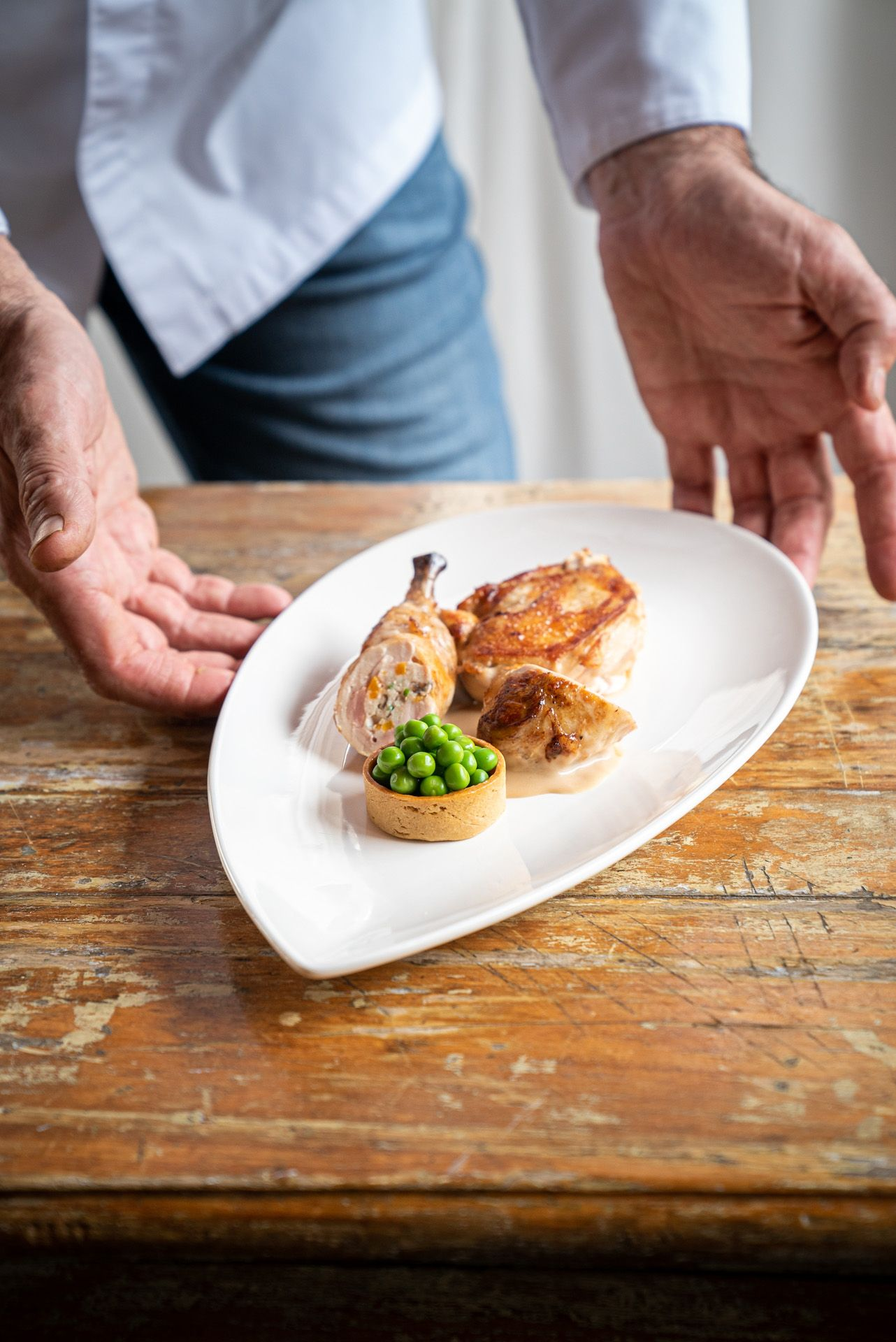meal of chicken and peas by chef Didier Leroy photographed by Bruno Florin for Van Houtte 100th anniversary