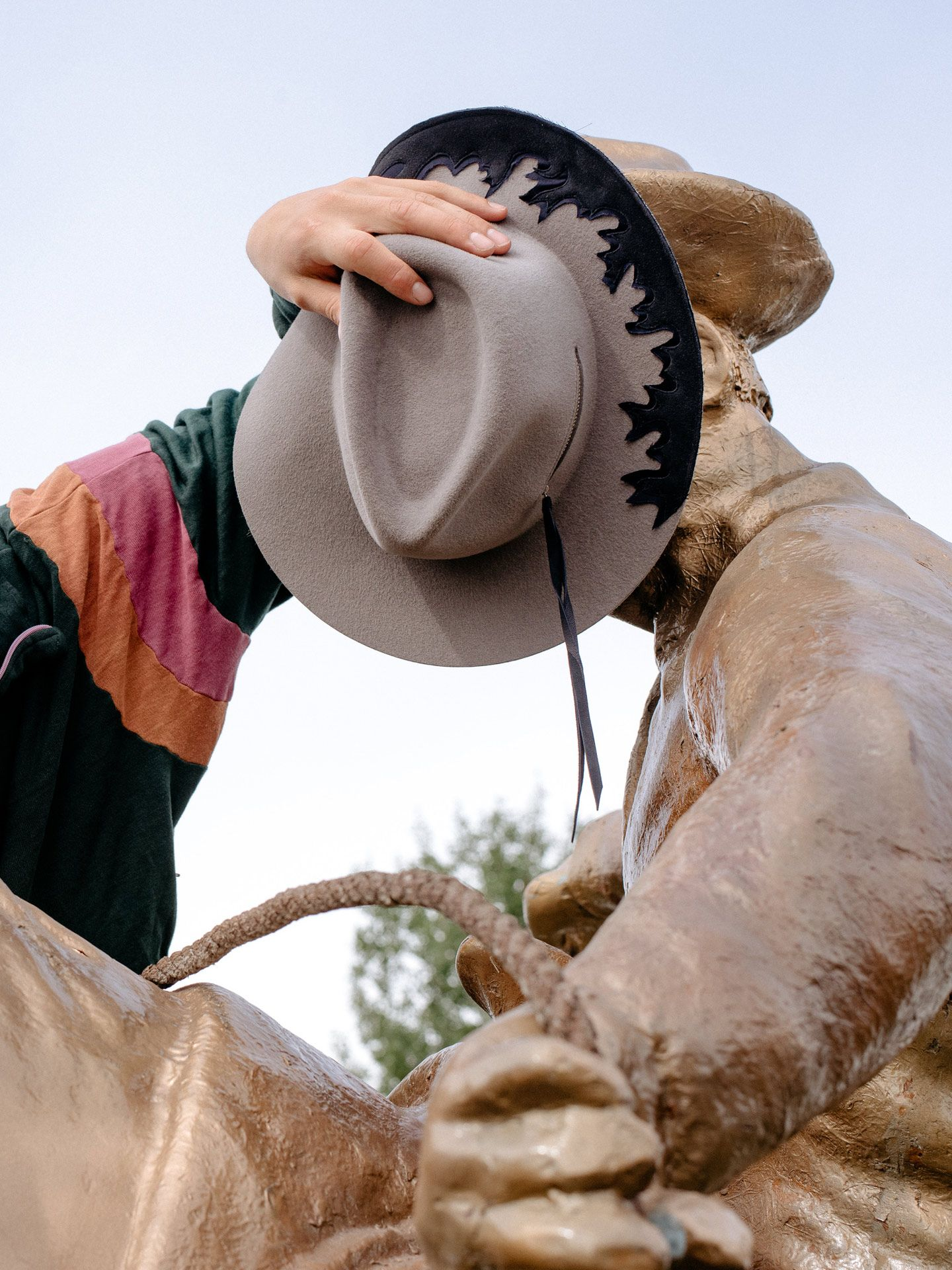cowboy hat being posed on statue by Alexi Hobbs for Larose Paris in St-Tite