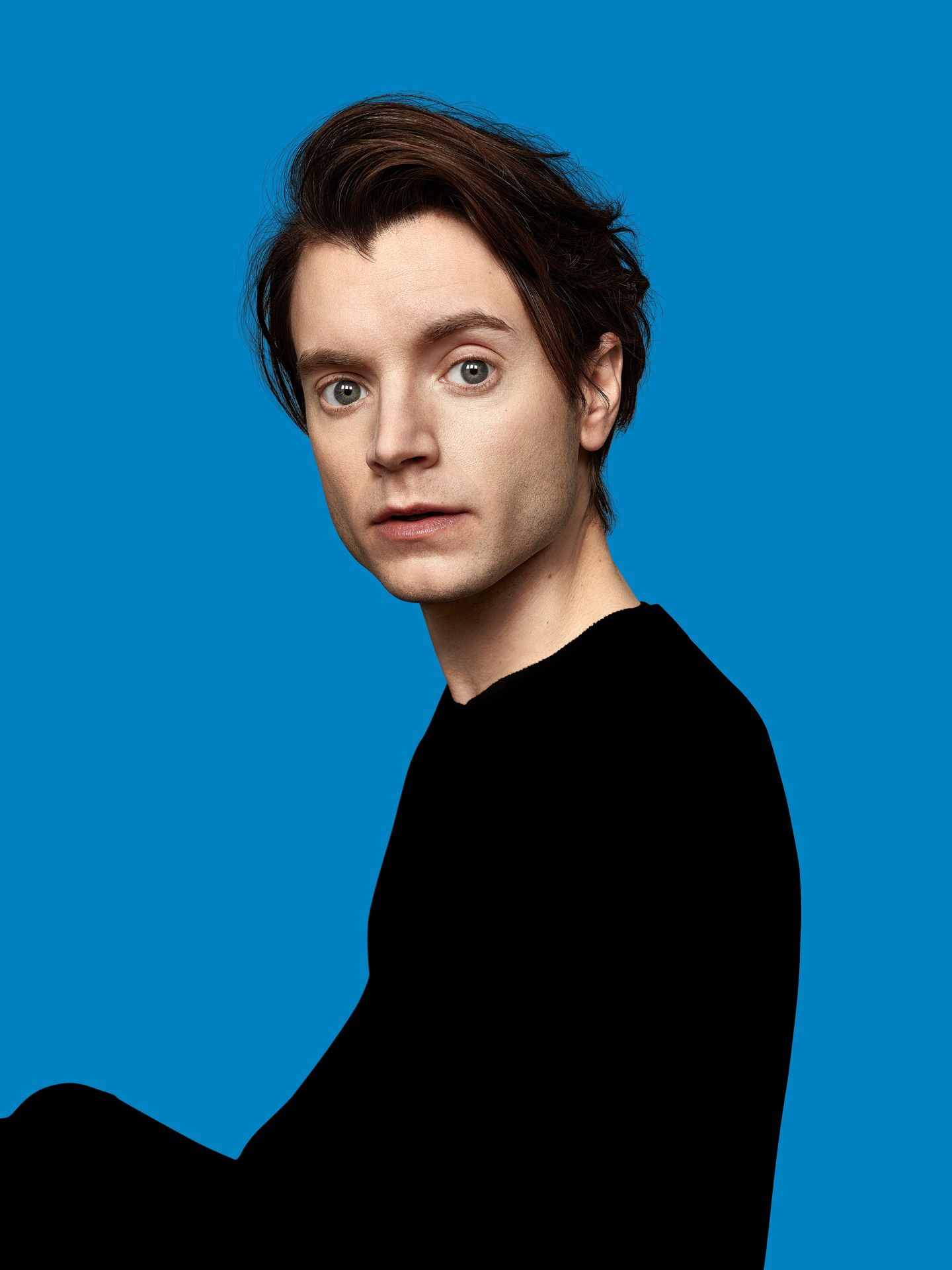 actor Sebastien Rebe on blue background by Maxyme G Delisle for Duceppe Theatre with Publicis