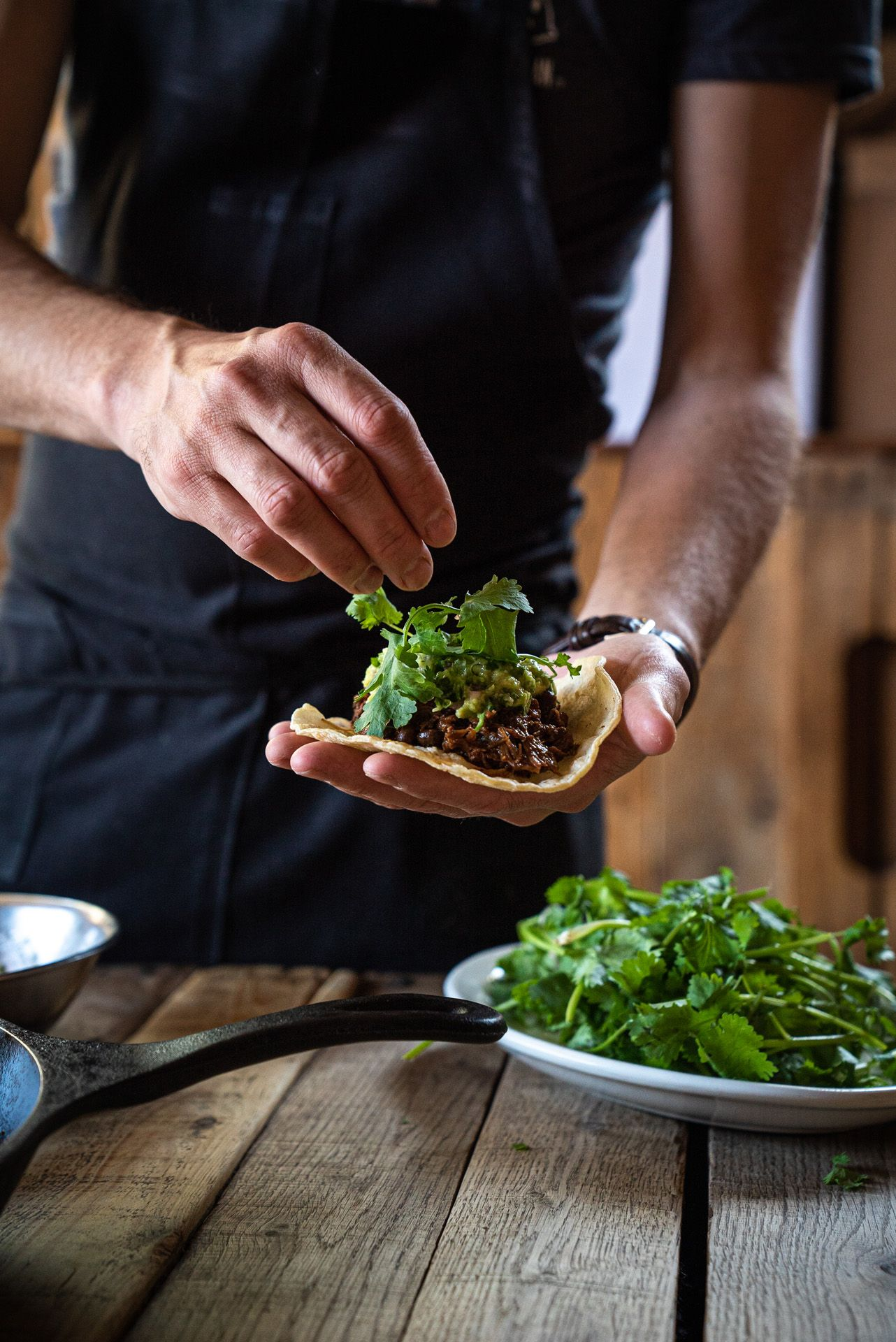 chef Sebastian Harrisson-Cloutier filling a taco with meat and cilantro by Bruno Florin for Van Houtte 100th anniversary