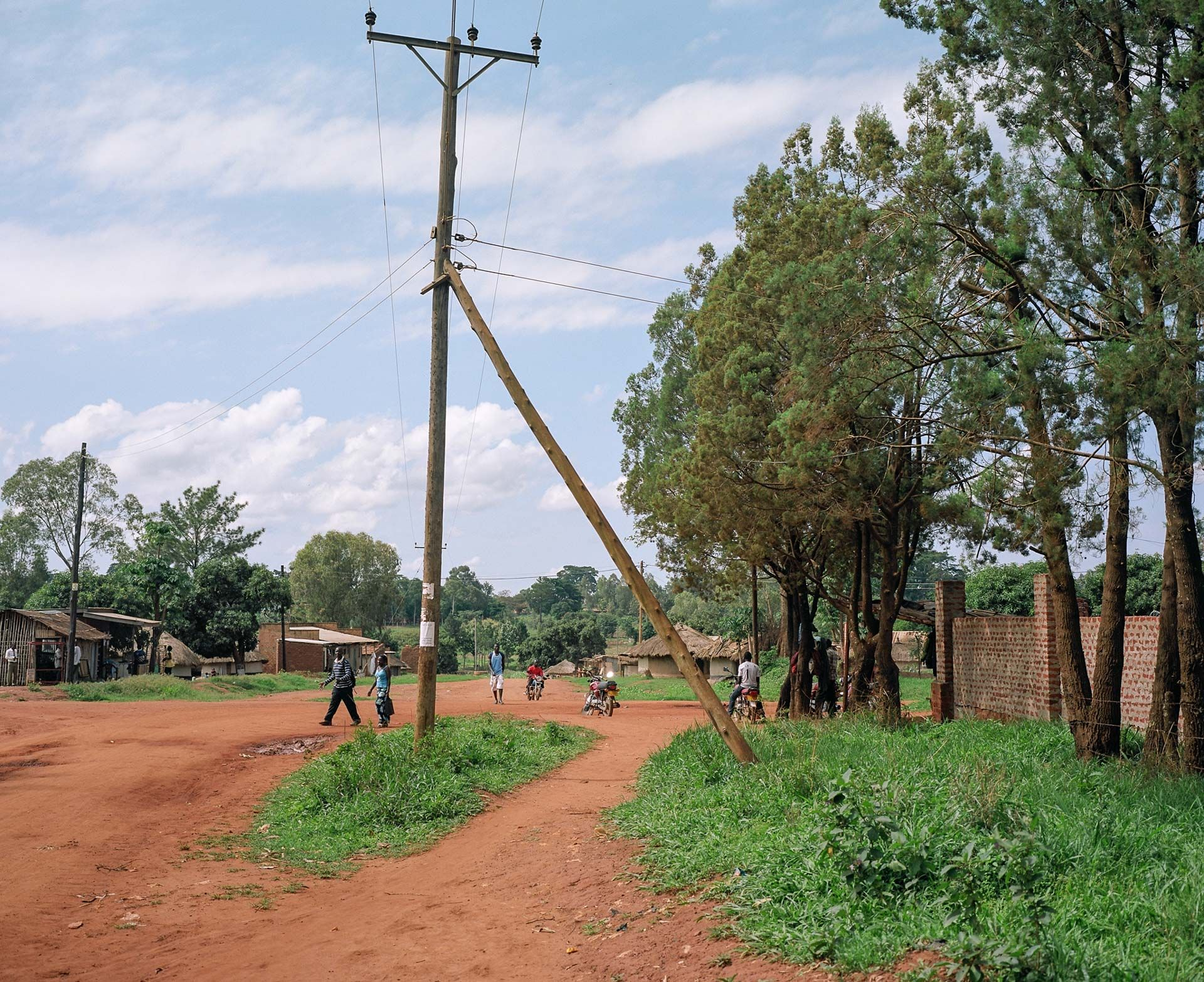 dirt roads in village by Alexi Hobbs in Uganda for Football for Good with Sportsnet