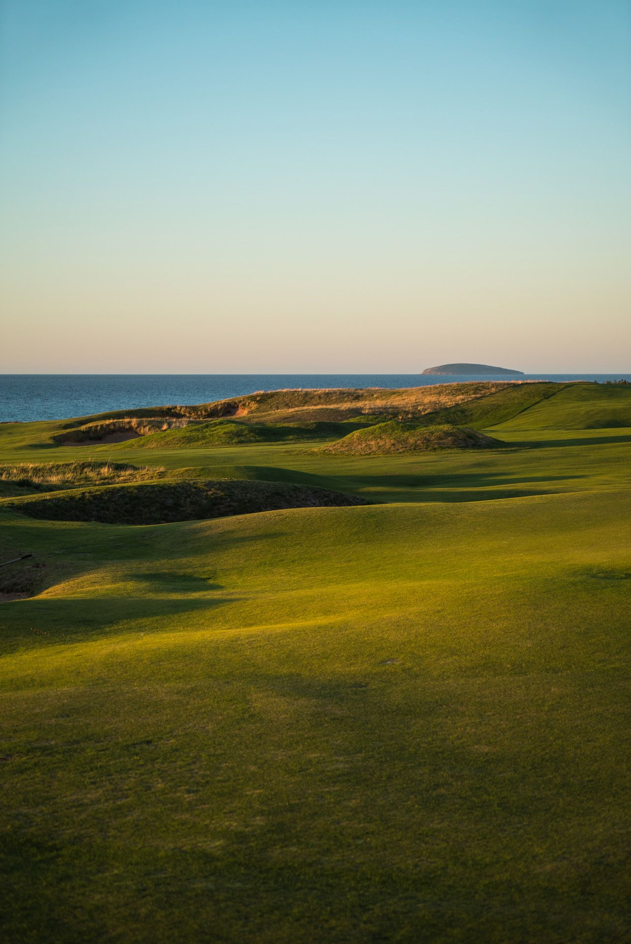 golf course on seaside in early morning light by Bruno Florin for Mercedes Magazine