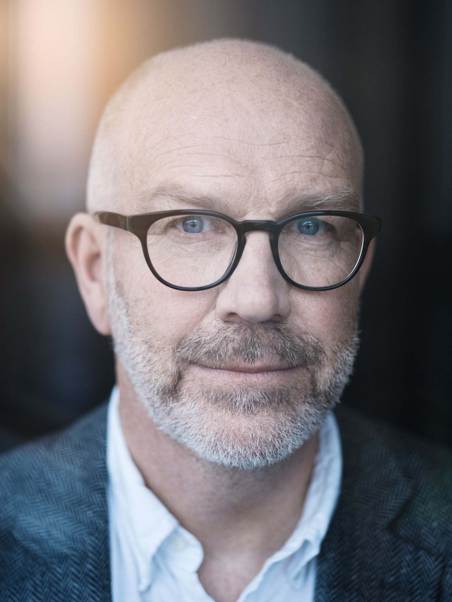 portrait of bald man with glasses by Alexi Hobbs for WSP
