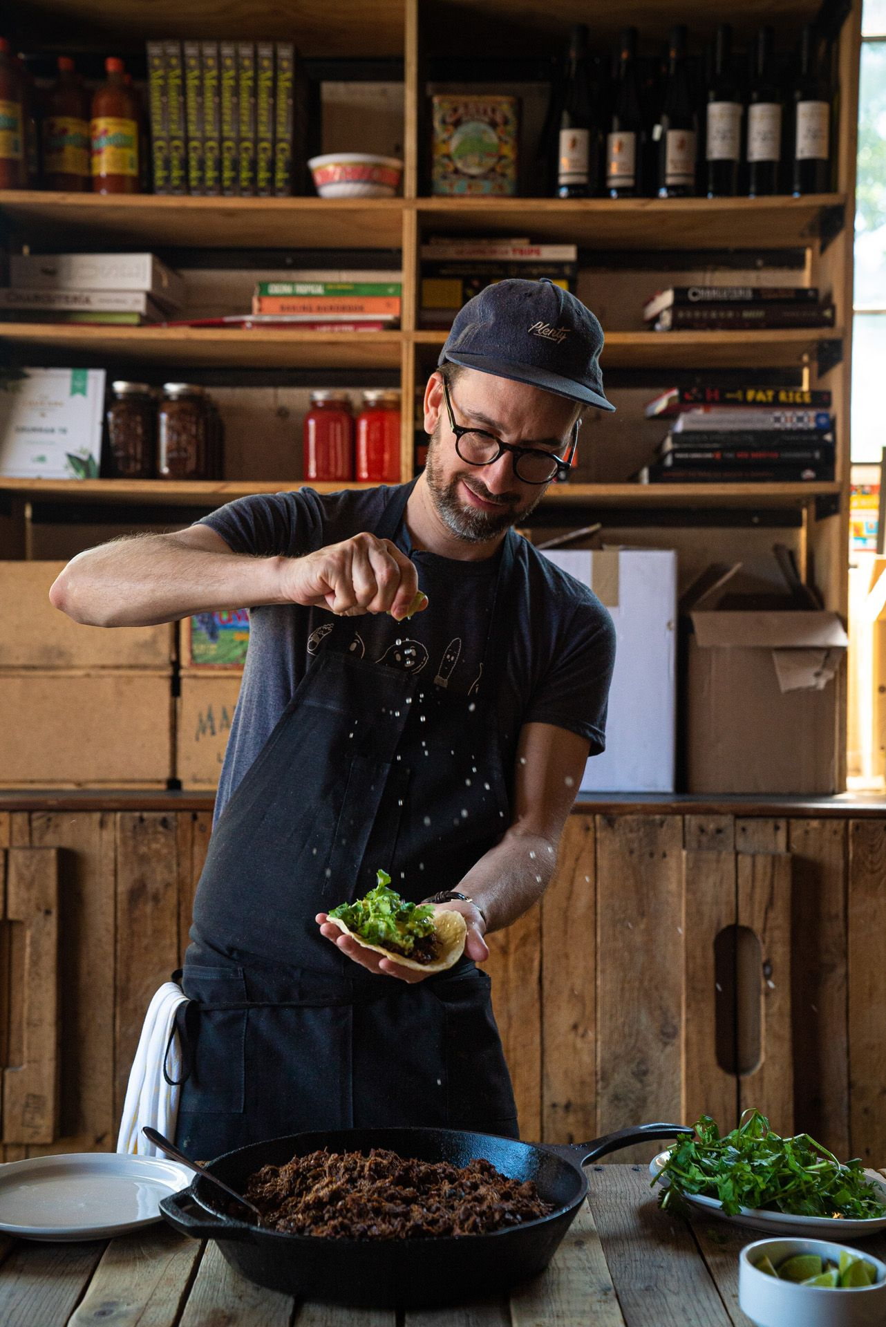 chef Sebastian Harrisson-Cloutier sprinkling salt on his meat taco by Bruno Florin for Van Houtte 100th anniversary