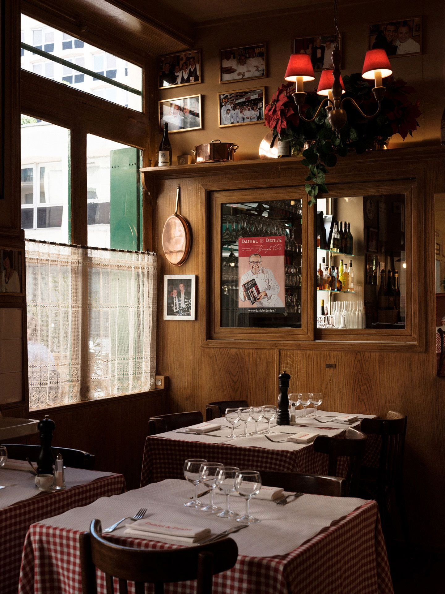 inside of a traditional french countryside restaurant with vichy tablecloth by Alexi Hobbs in Auvergne for Reflets de France
