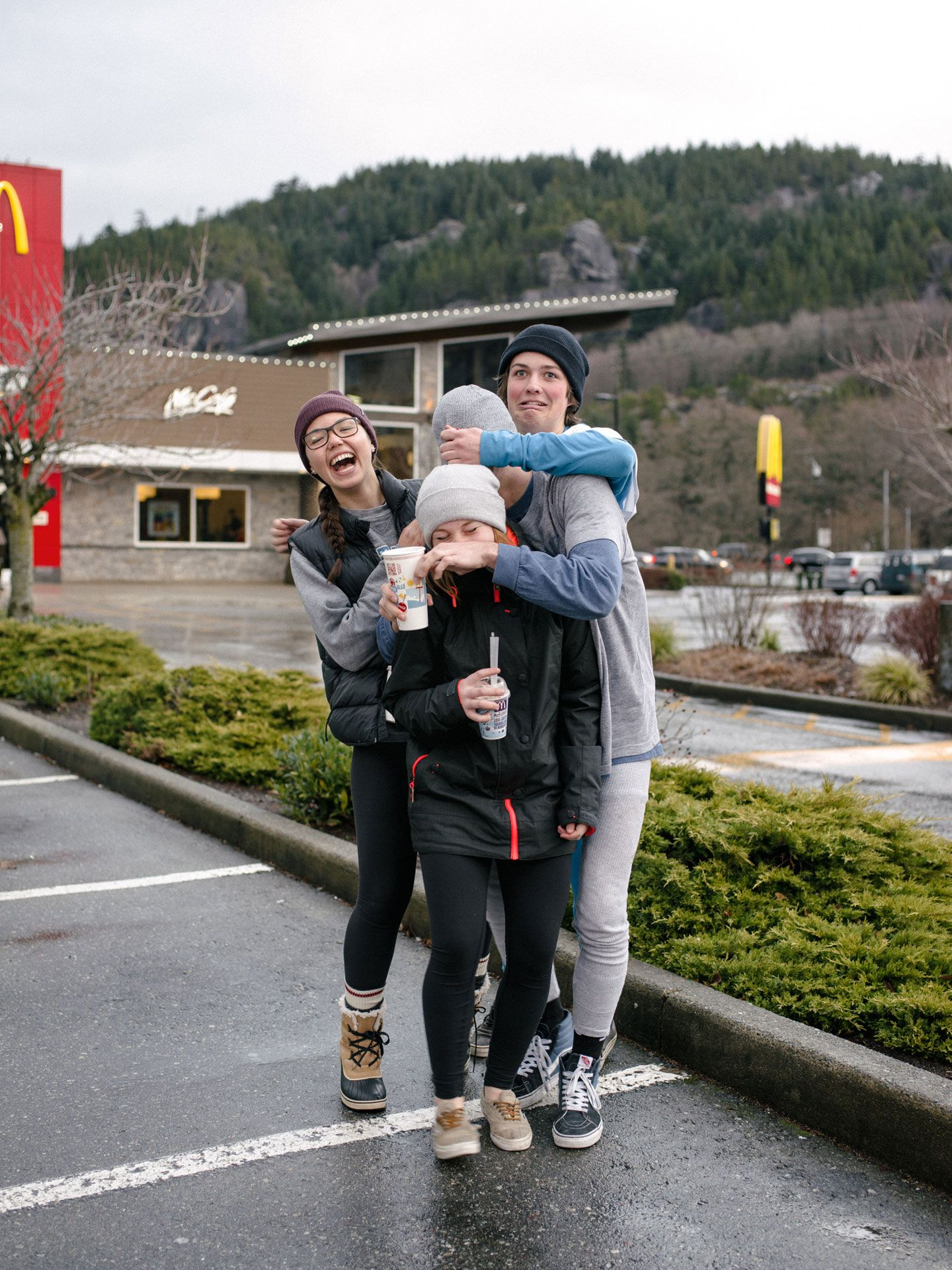 group of teenagers laughing playing and teasing eachother by Alexi Hobbs for McDonald's