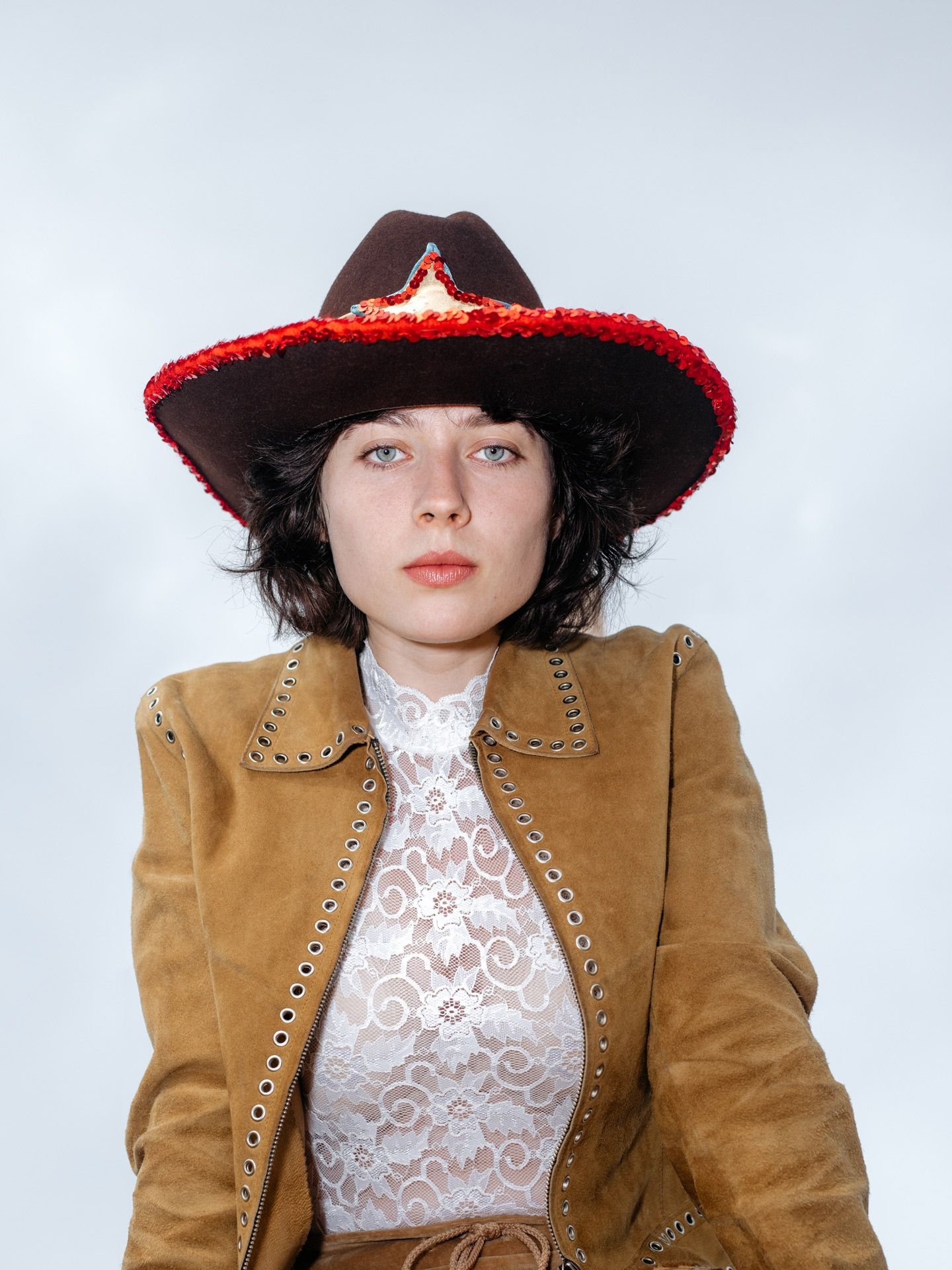 portrait of black haired girl with blue eyes wearing cowboy attire by Alexi Hobbs for Larose Paris in St-Tite