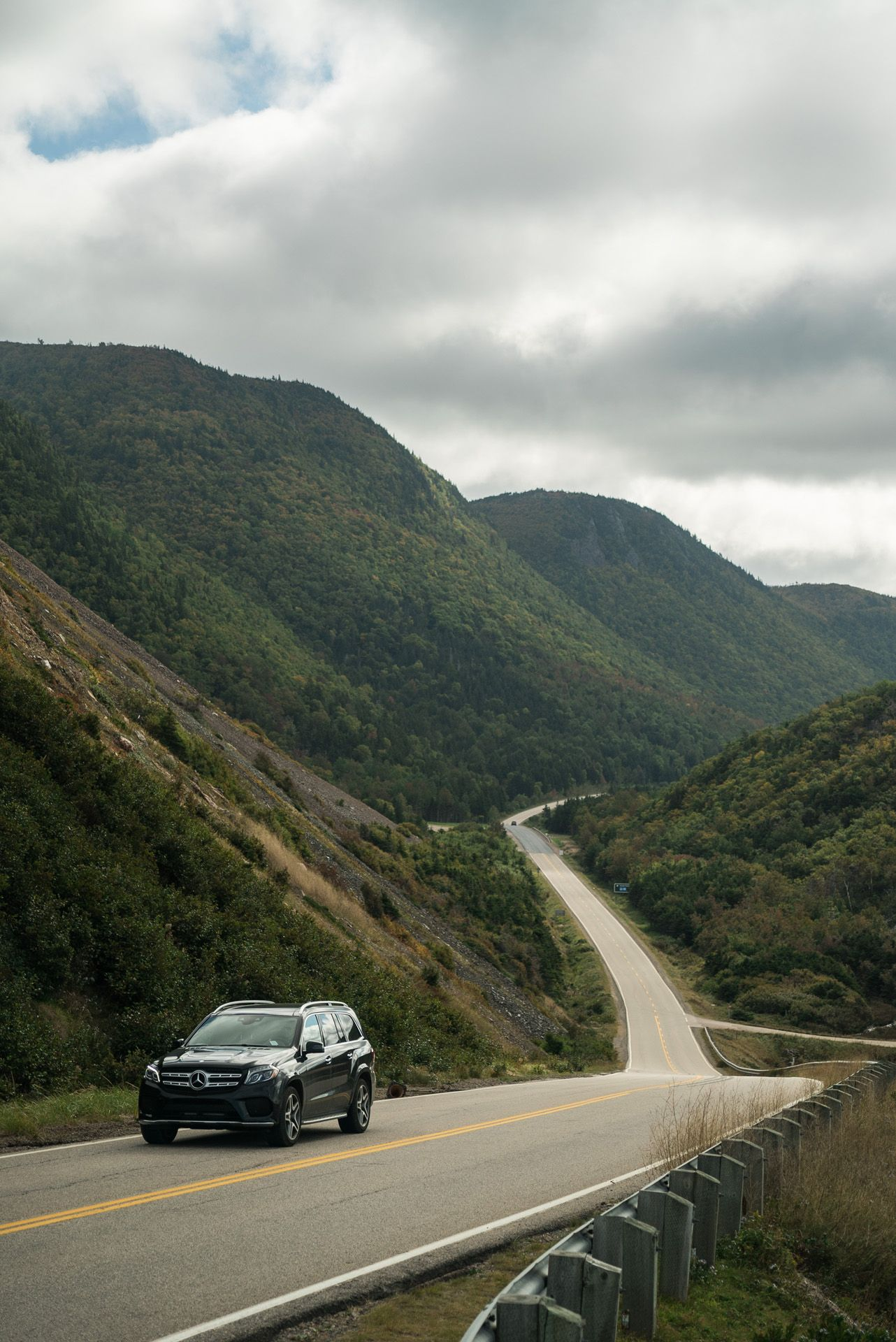 mercedes benz car on the road in between mountains by Bruno Florin for Mercedes Magazine