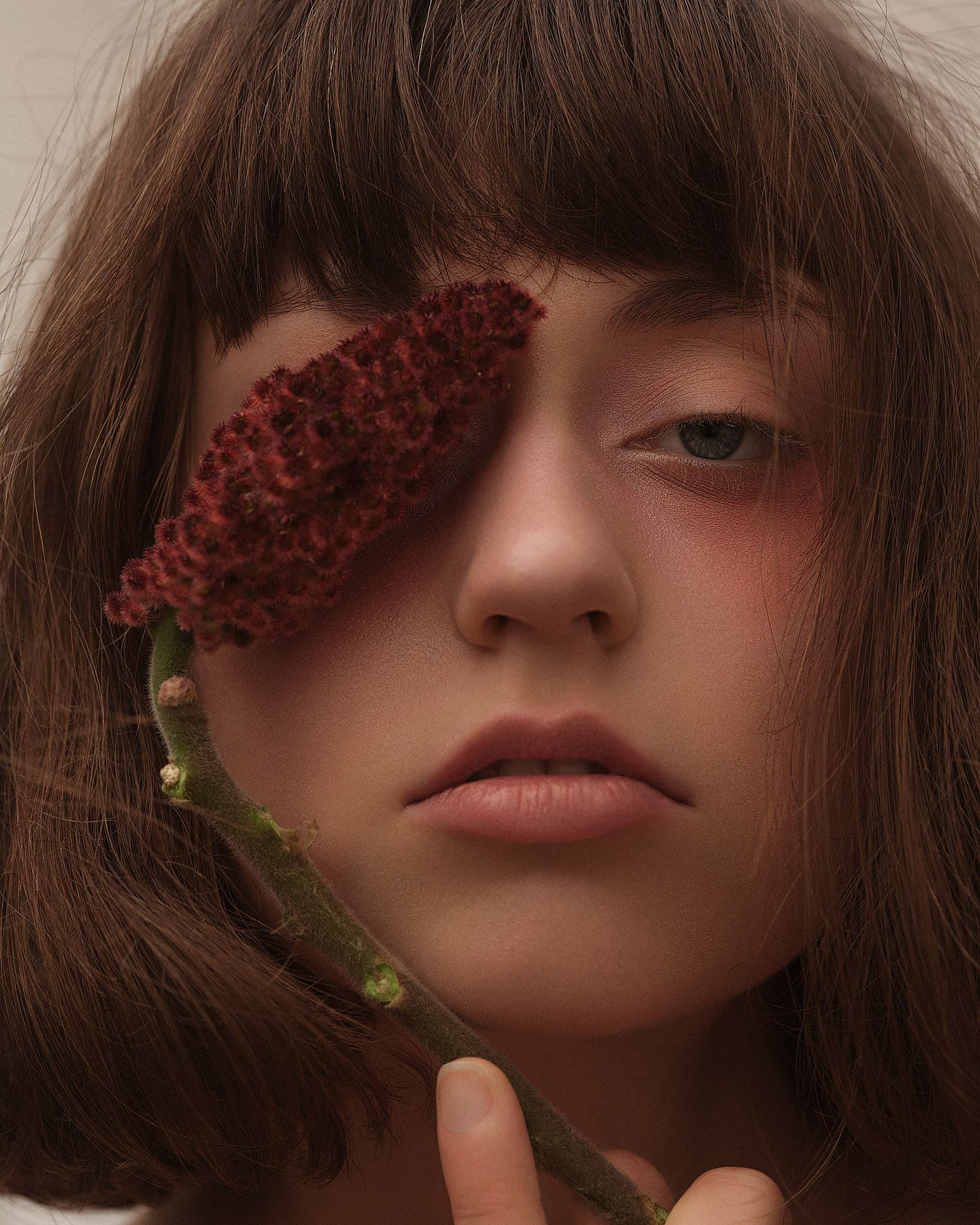 model Delphine with pink eyeshadow with fluffy plant over her eye by Maxyme G Delisle for Flanelle Magazine