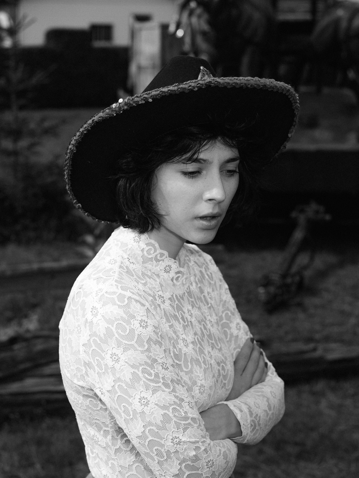 black haired girl wearing cowboy hat in black and white by Alexi Hobbs for Larose Paris in St-Tite