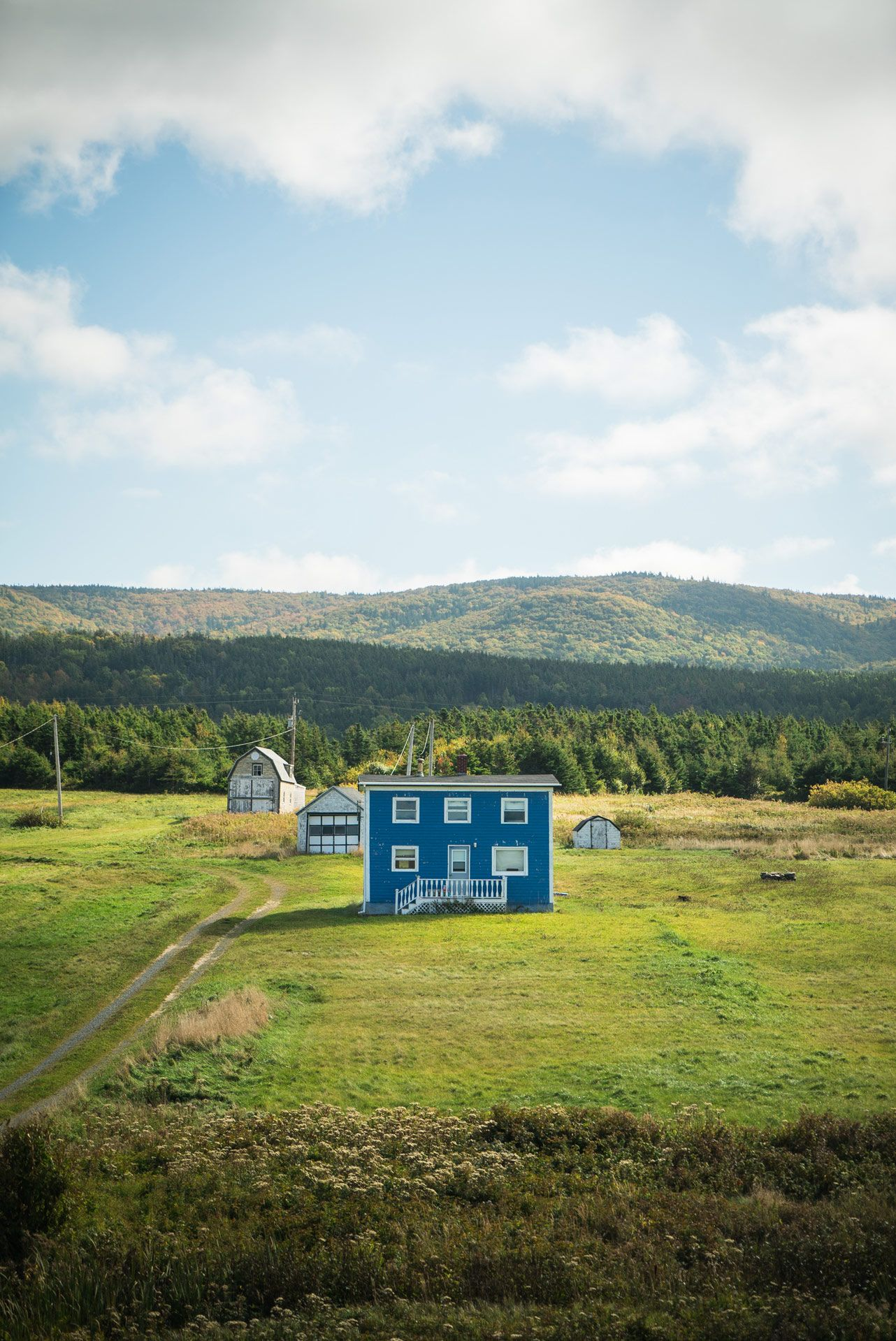 little blue house in middle of nowhere by Bruno Florin for Mercedes Magazine