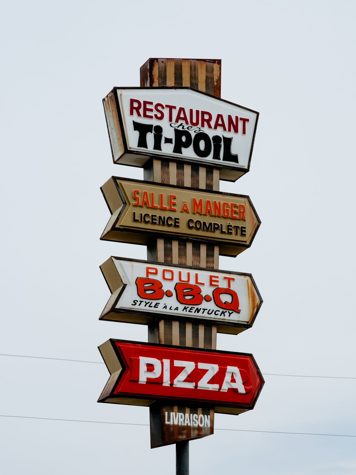 many vintage signs of quebecois restaurants in french by Alexi Hobbs for Larose PAris in St-Tite