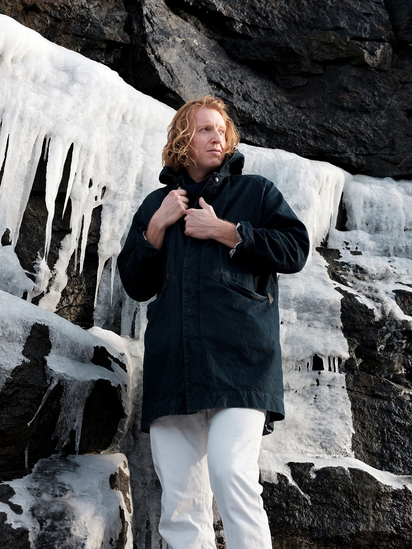 portrait of Richard Reed Parry ginger male in winter next to frozen waterfall by Guillaume Simoneau