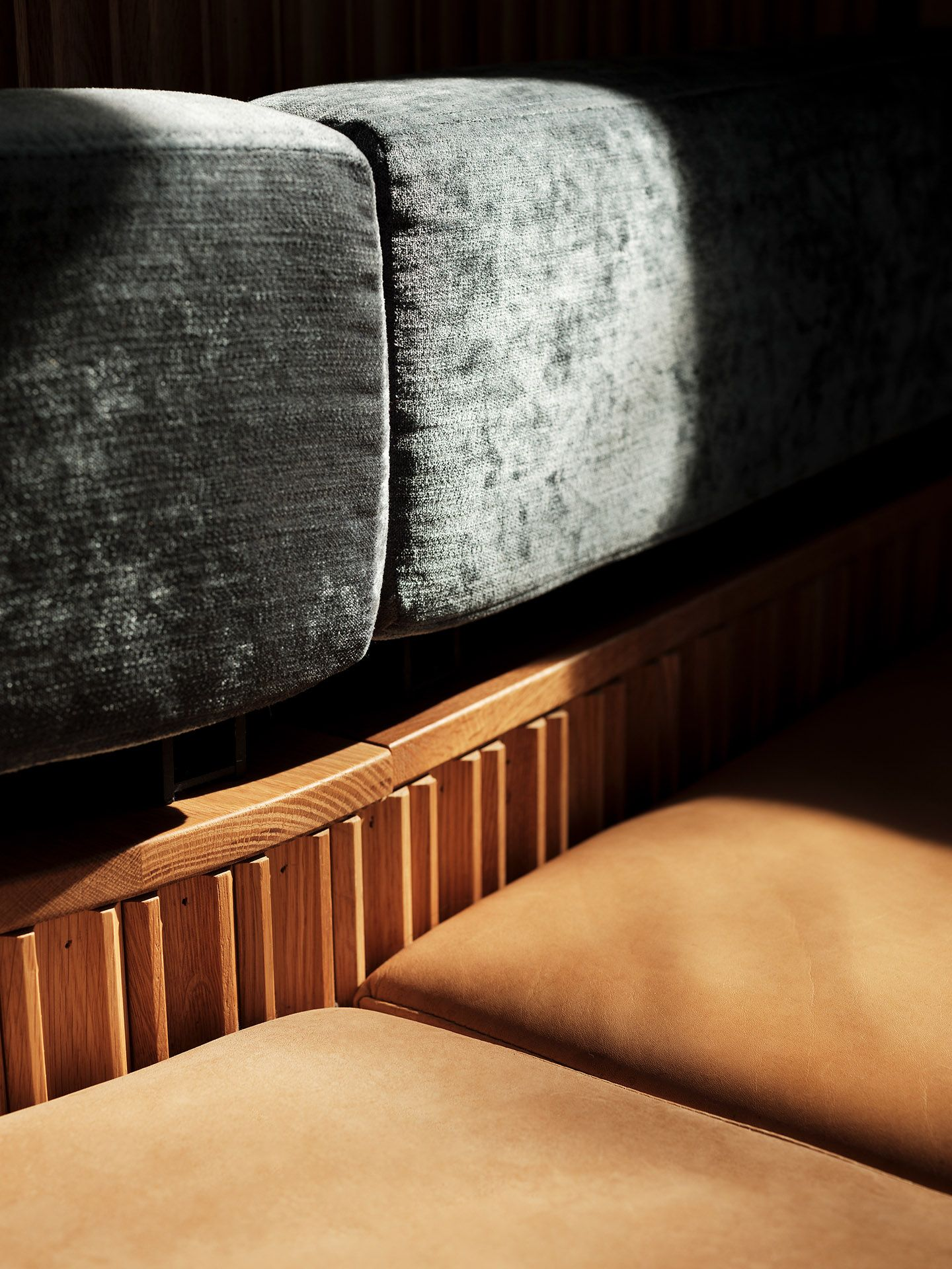 close up of booth bench with seats in caramel leather and back made of grey velvet by Guillaume Simoneau at MRDK for NUVO