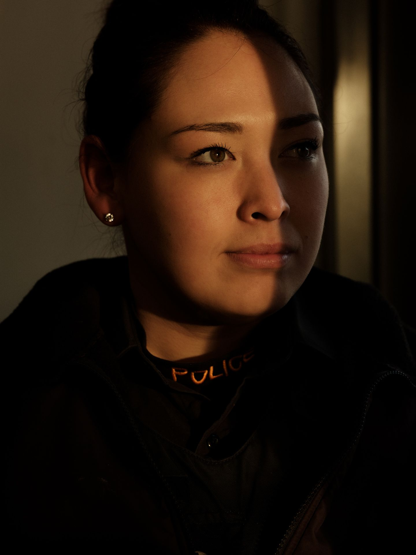 portrait of constable Pamela Stevenson, the only female Inuk police officer on the Kativik Regional Police Force in Nunavik by Alexi Hobbs for Air Inuit