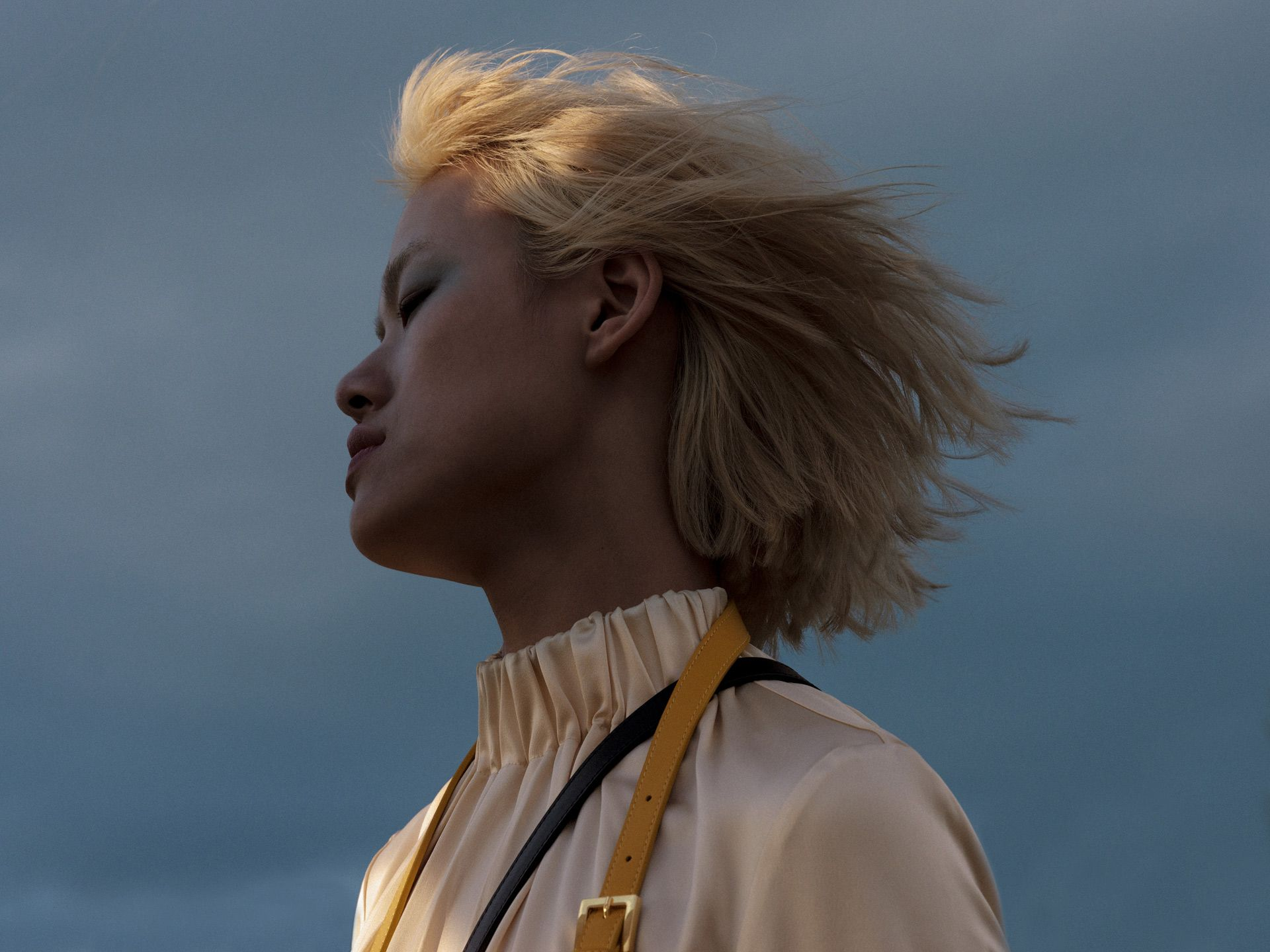 close portrait of asian model with hair in the wind photographed by Alexi Hobbs for Want Les Essentiels Spring Summer 2019 collection