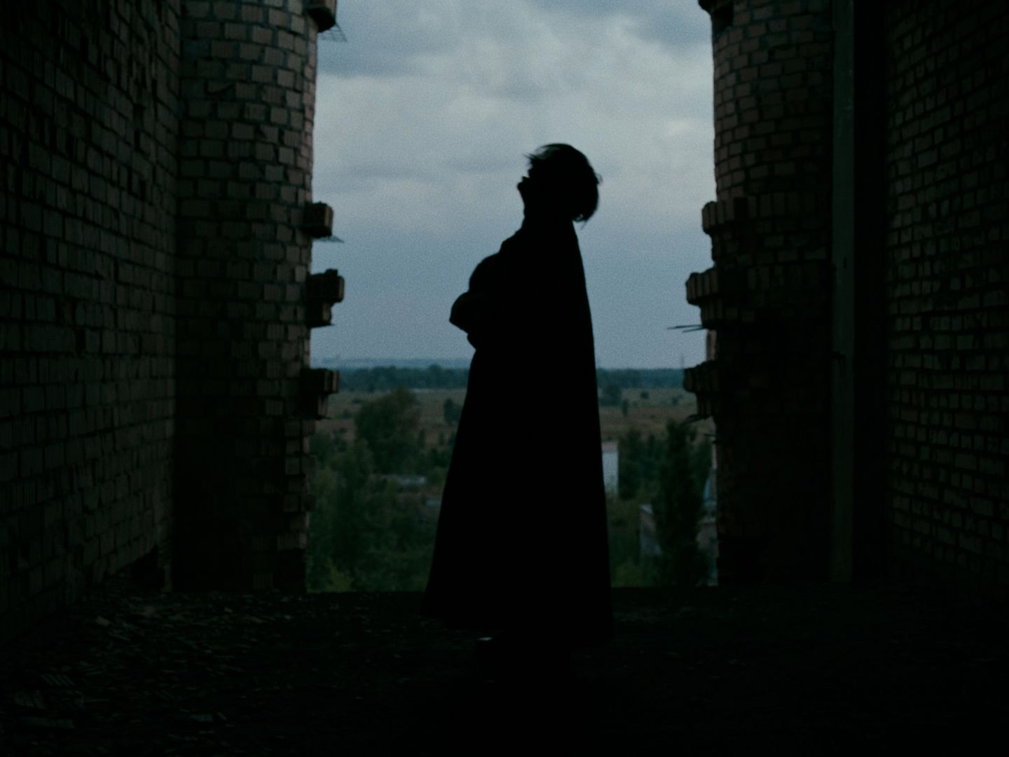 Apashe's silhouette in an abandonned building in Ukraine
