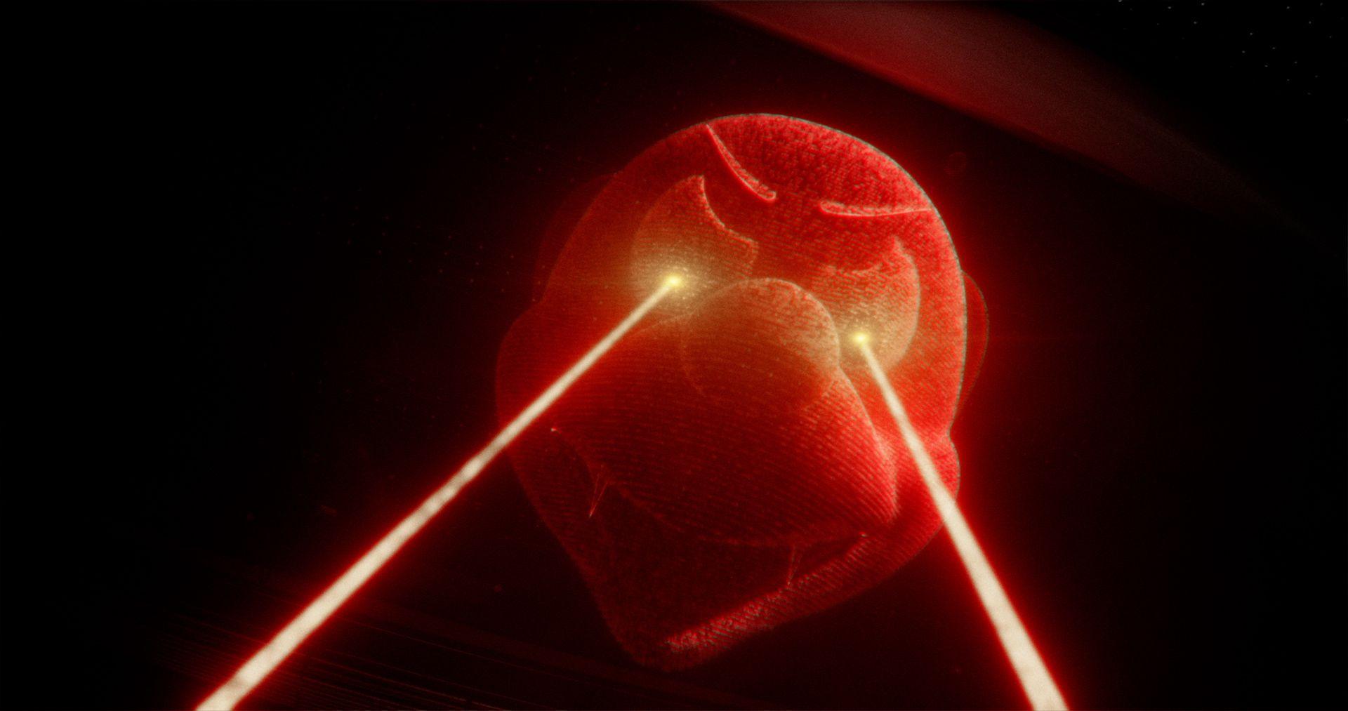 Arrêt sur image d'une souris rouge animée en effet spéciaux tirant des rayons laser avec ses yeux.