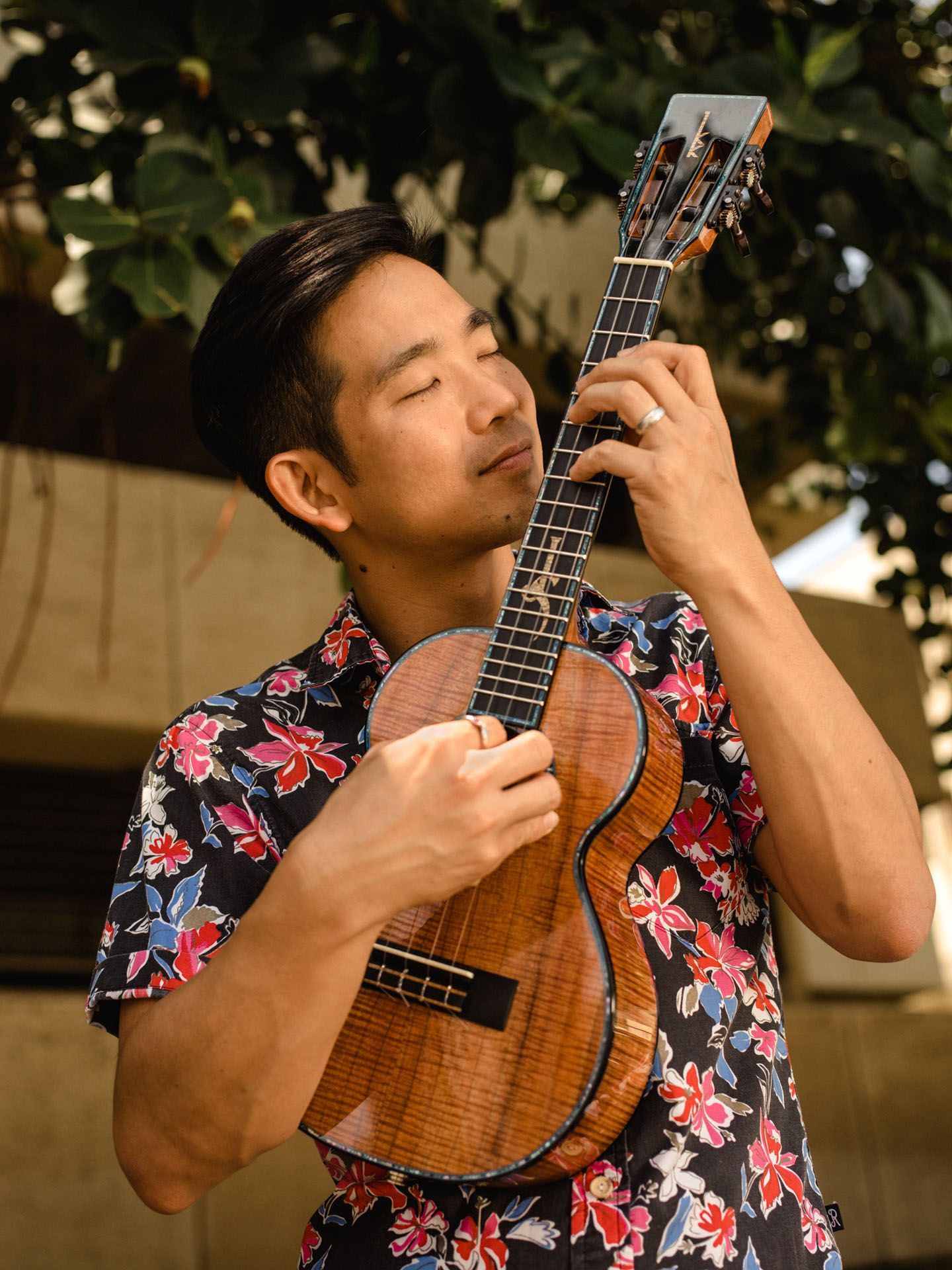 native hawaiian male playing ukulele by Alexi Hobbs in Hawaii for en Route