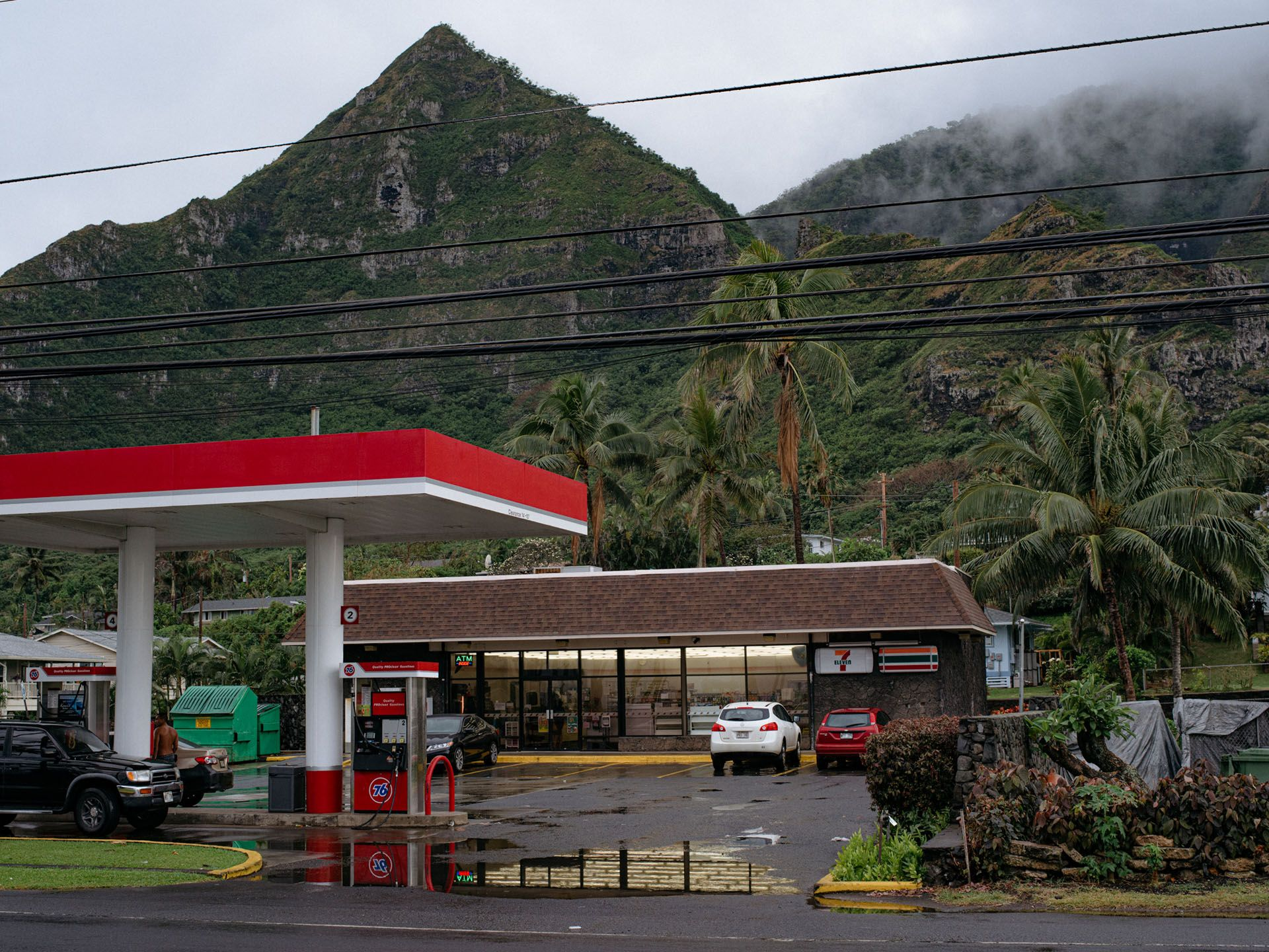 corner store with mountain behind by Alexi Hobbs in Hawai'i for enRoute Magazine