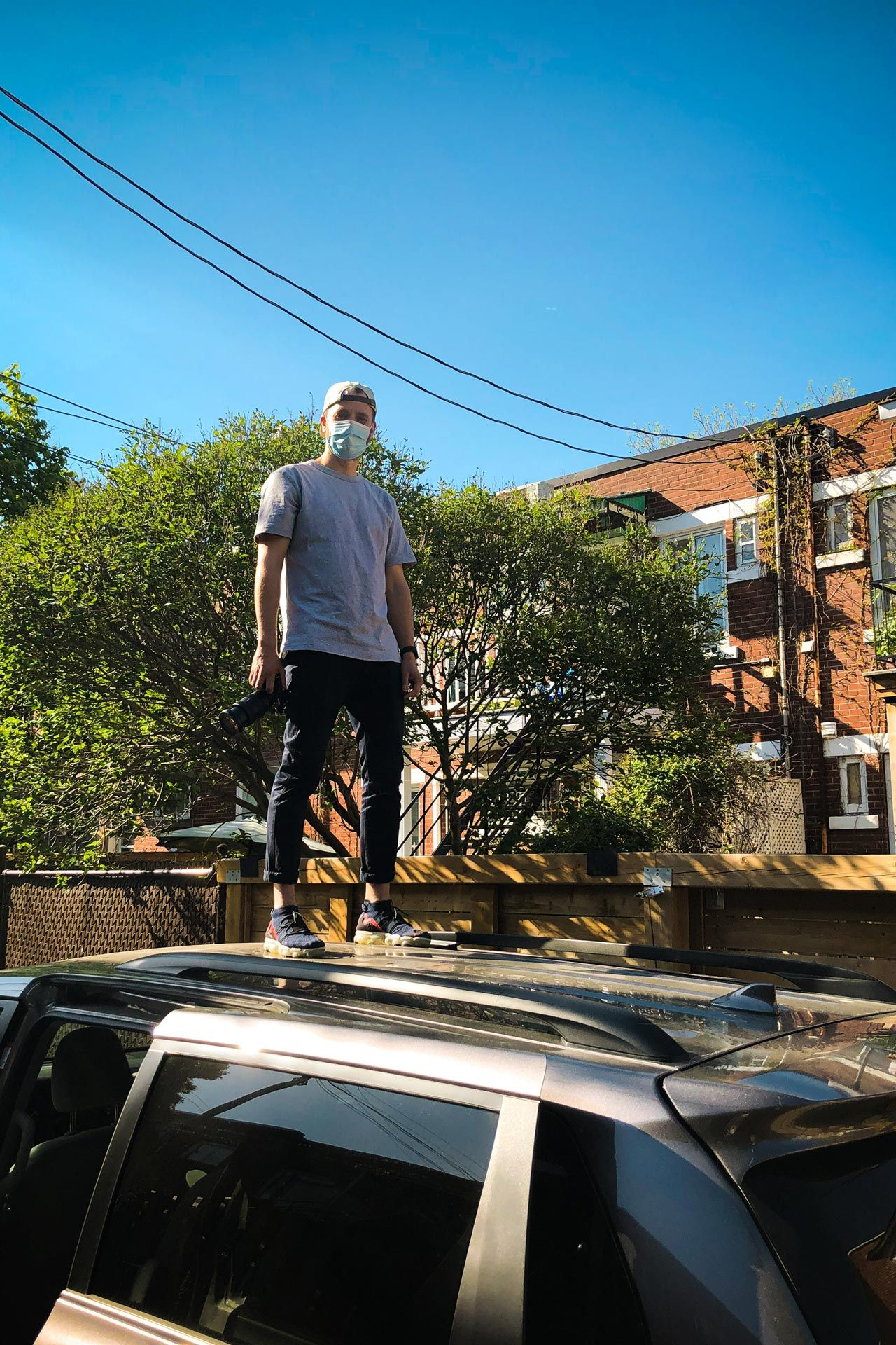 Consulat's photographer Bruno Florin standing on top of a car in behind the scenes for shoot for Belle Gueule with Forsman & Bodenfors