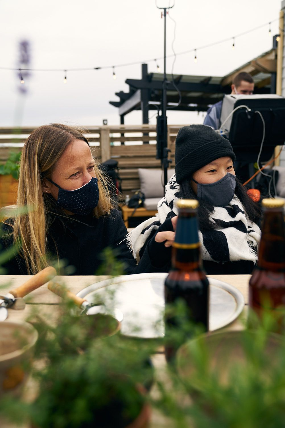 two woman preparing table while wearing masks in behind the scenes for shoot photographed by Bruno Florin for Belle Gueule with Forsman & Bodenfors