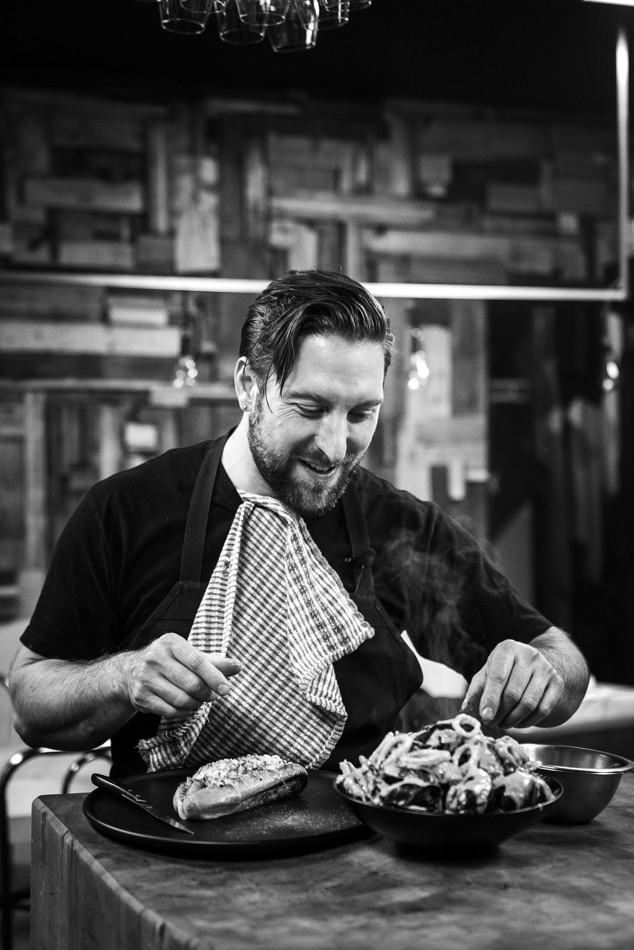 black and white portrait of Mile-Ex restaurant chef Gregory Paul about to eat by Bruno Florin